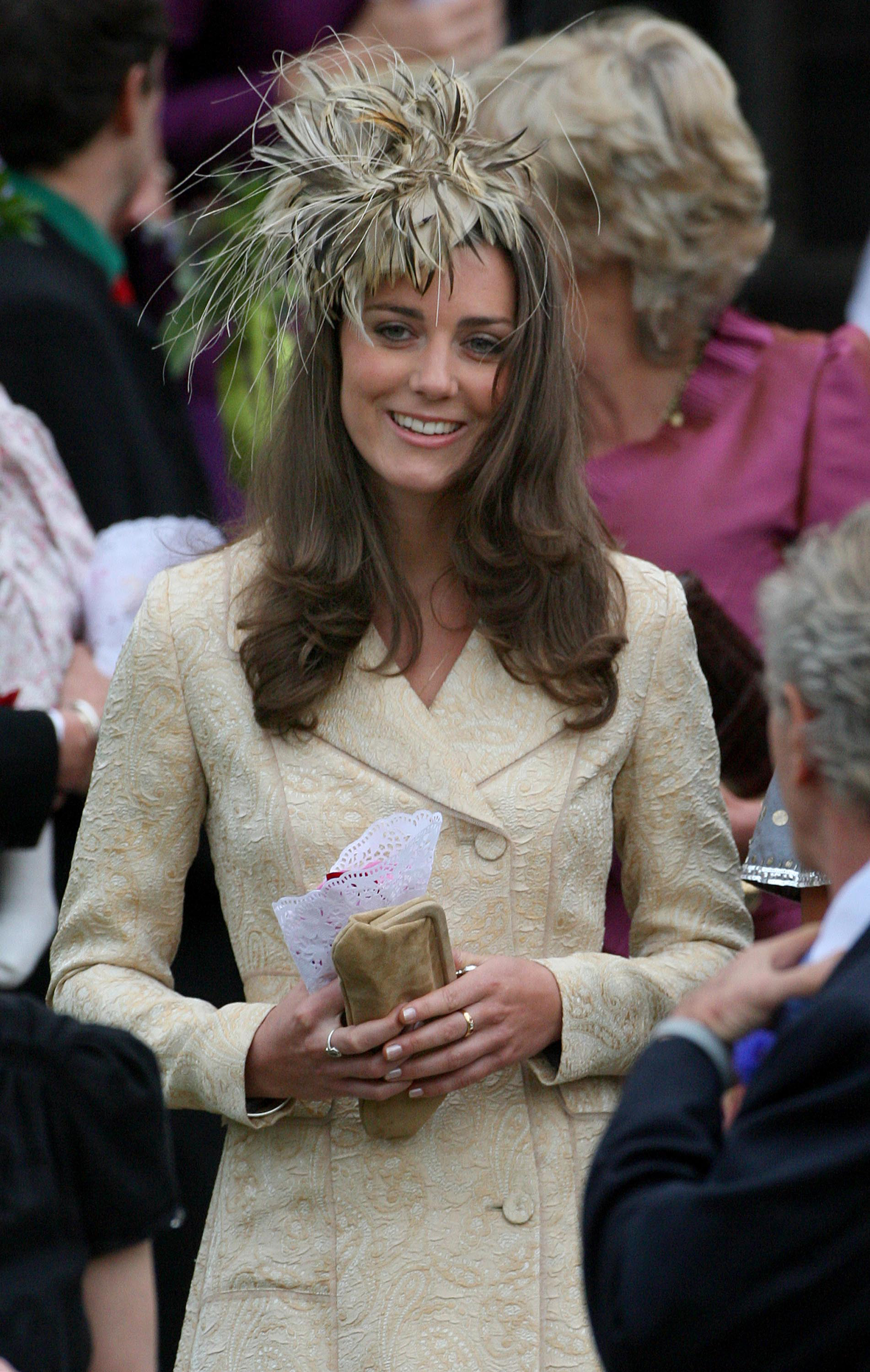 <strong>Hallmark Hat</strong>                                   At the wedding of Prince Charles and Camilla Parker Bowles on May 6, 2006, Middleton showed her trademark style: fitted trench coat and extravagant headpiece. Her attendance solidified her status as official royal girlfriend and further fueled engagement rumors.