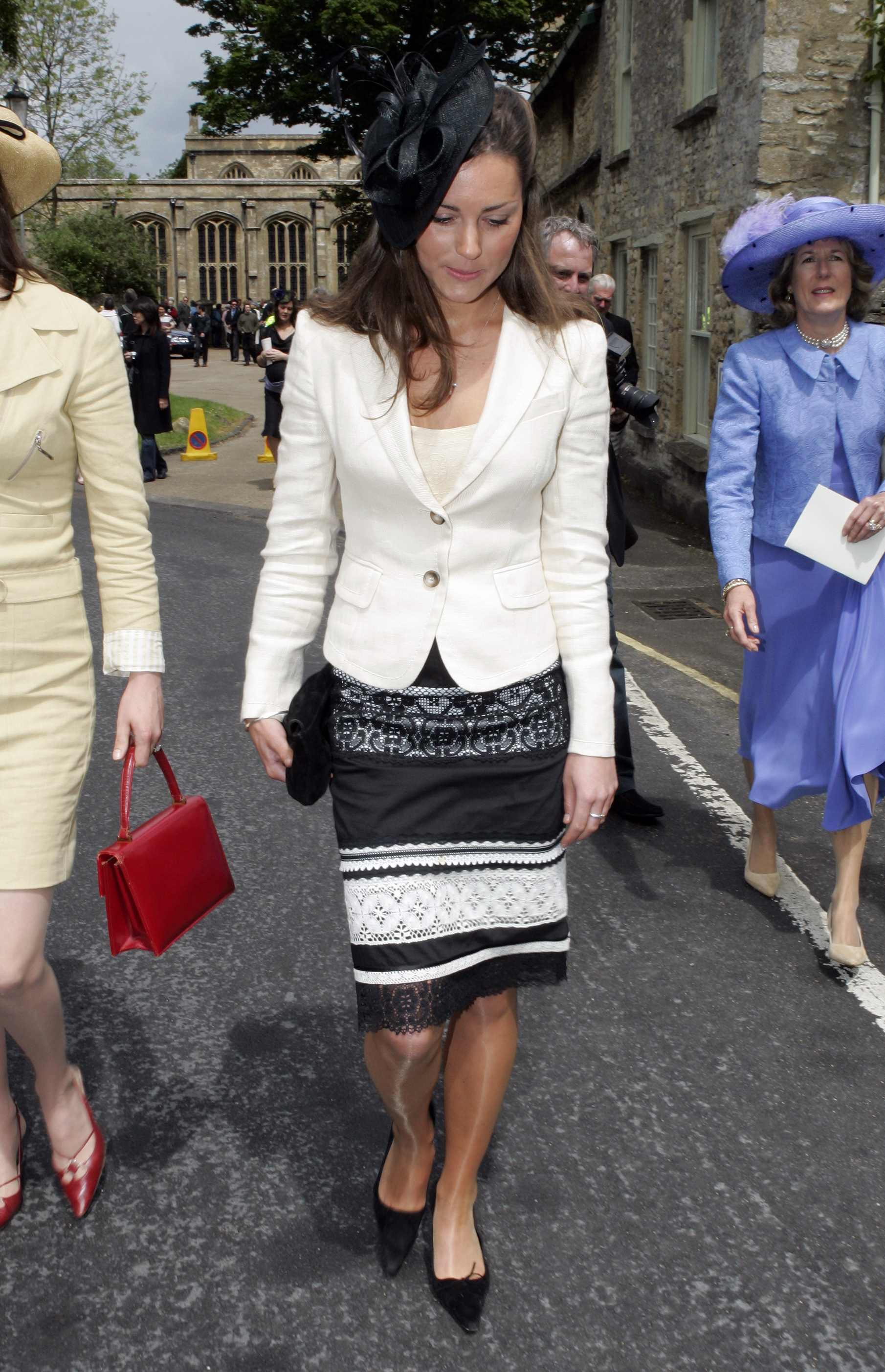 <strong>Black and White and Fashionable All Over</strong>                                   In classic Kate fashion, Middleton attended a friend's wedding in a blazer and fitted skirt. June 4, 2005