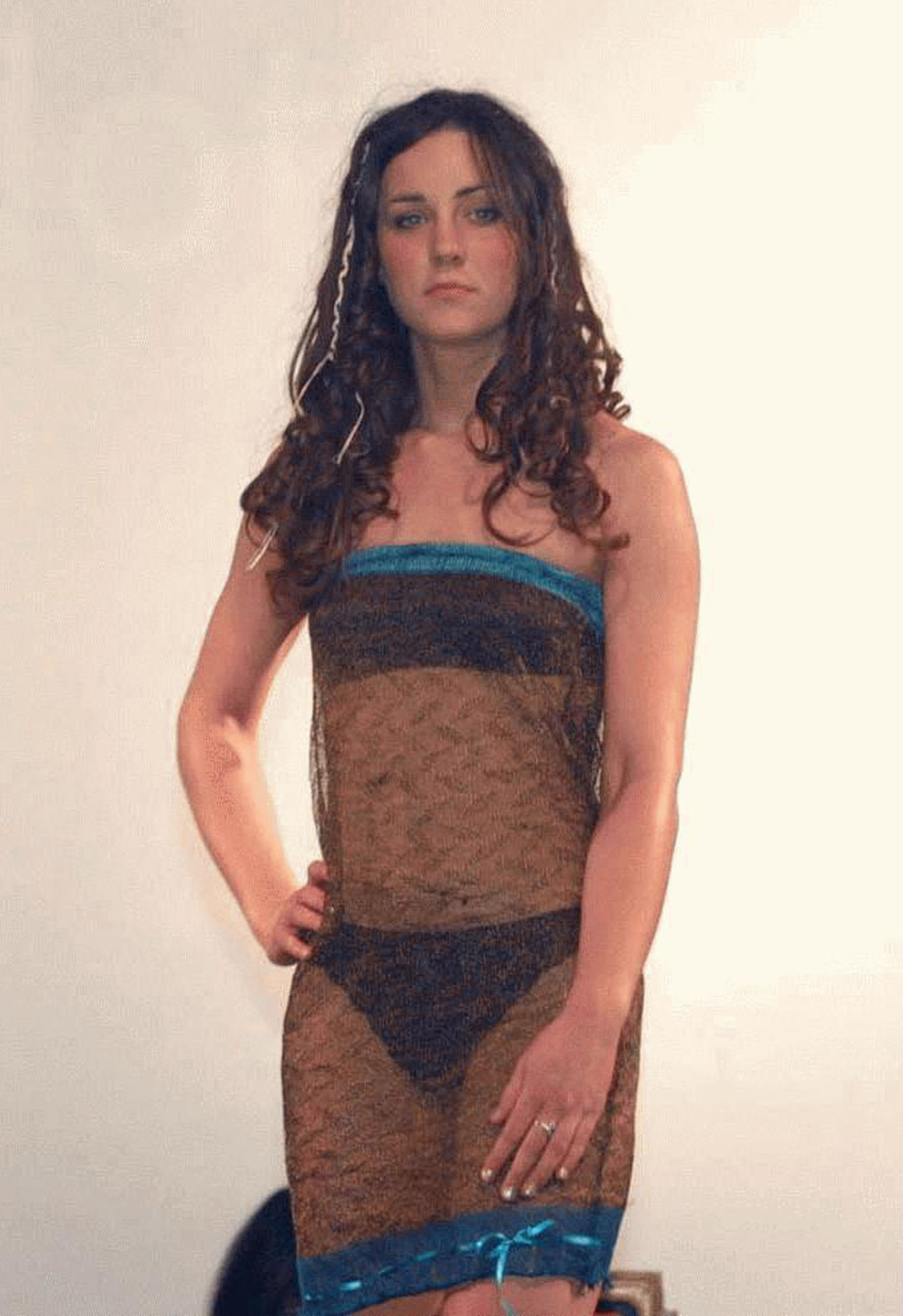 "<strong>The ""She's Hot!"" Dress</strong>                                   Middleton in the now famous sheer dress that first caused Prince William to think of her as more than a friend. The brown number, which Middleton wore at a charity fashion show in college on March 26, 2002, sold at a London auction for $125,890 in March 2011."