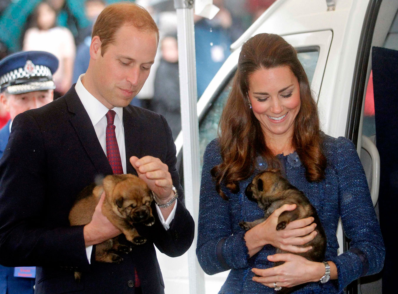 <strong>Focus on the Puppies</strong>From left: Prince William, Duke of Cambridge, and Catherine, Duchess of Cambridge, hold police dog puppies at the Royal New Zealand Police College in Wellington, New Zealand, on April 16, 2014.