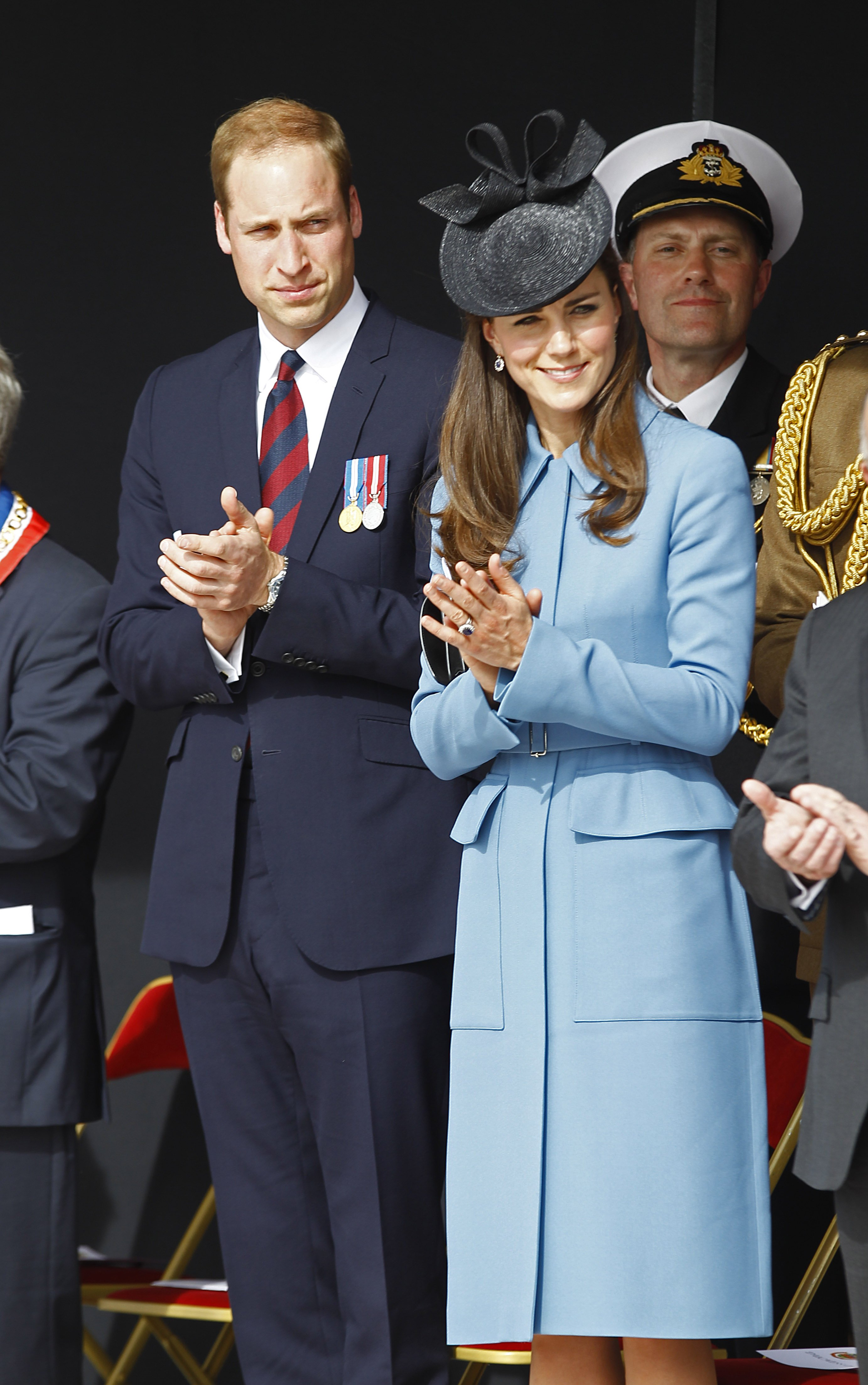 <strong>Mad Hatter</strong>Prince William, Duke of Cambridge and Kate the Duchess of Cambridge applaud during a remembrance ceremony in Arromanches, France, on June 6, 2014.