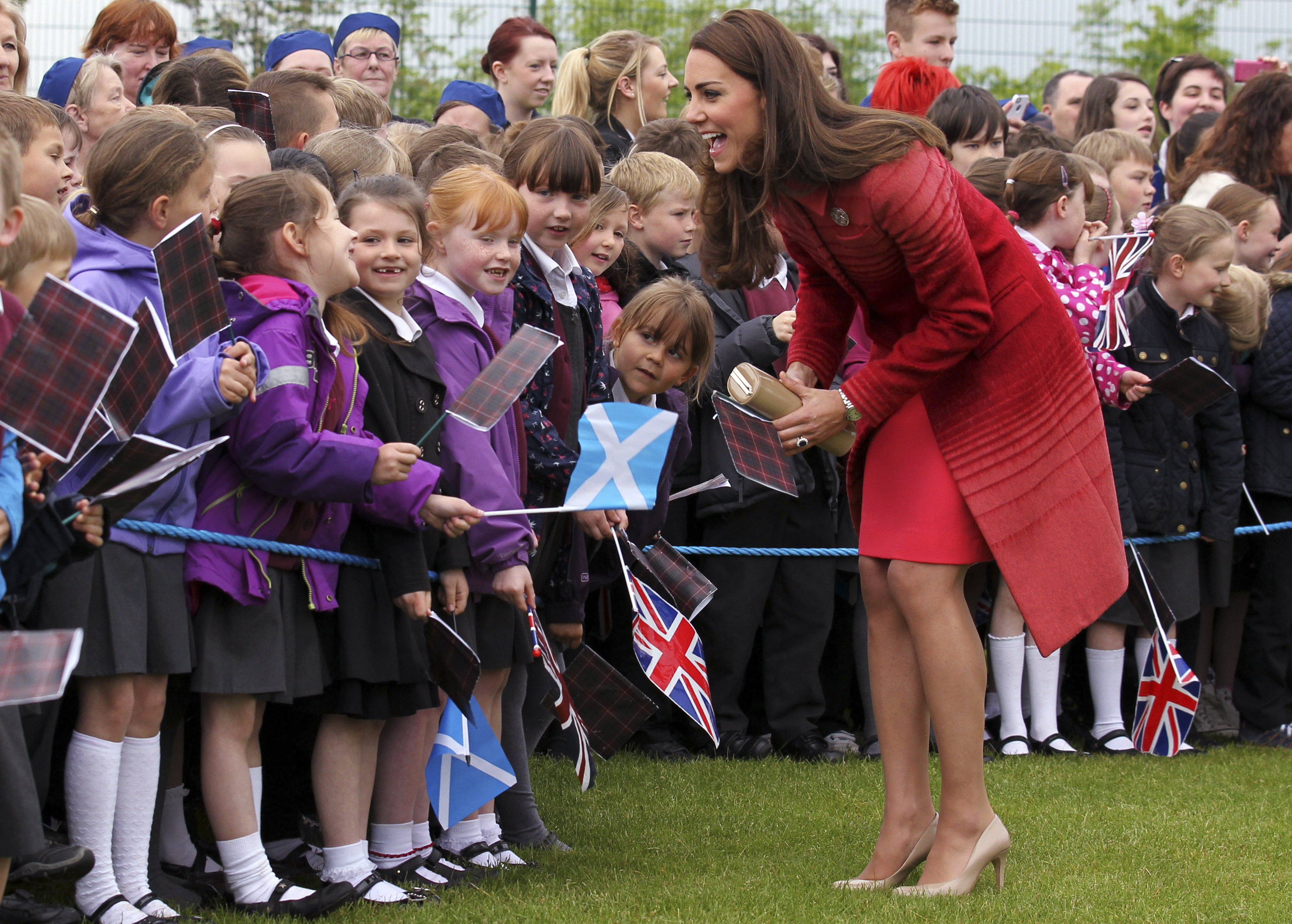 <strong>Lady in Red</strong>Britain's Catherine, the Duchess of Cambridge, meets pupils and community members during a visit to the Strathearn Community Campus at Crieff in Scotland on May 29, 2014.