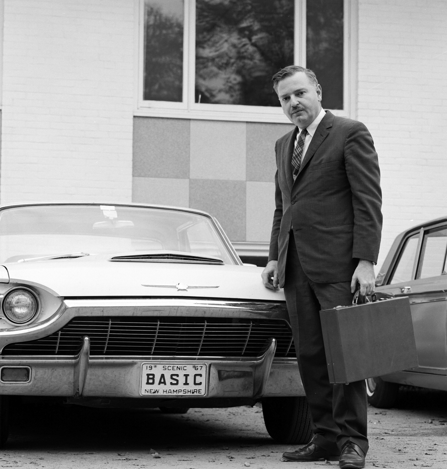 John Kemeny shows off his vanity license plate in 1967