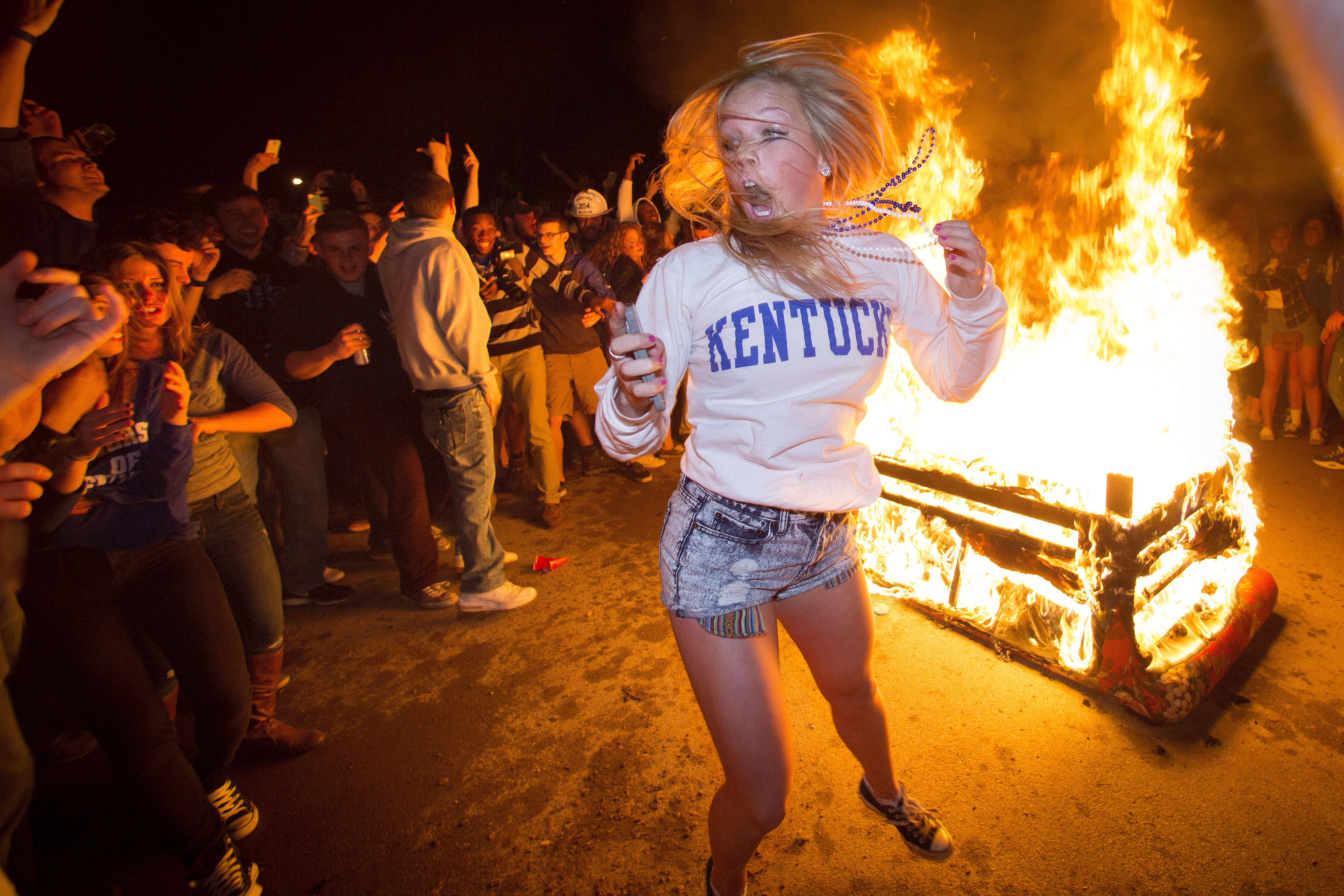 University of Kentucky fans celebrate on State Street after their team's come from behind victory over the University of Louisville to advance to the Elite 8 in the NCAA Men's Basketball Tournament on March 28, 2014.