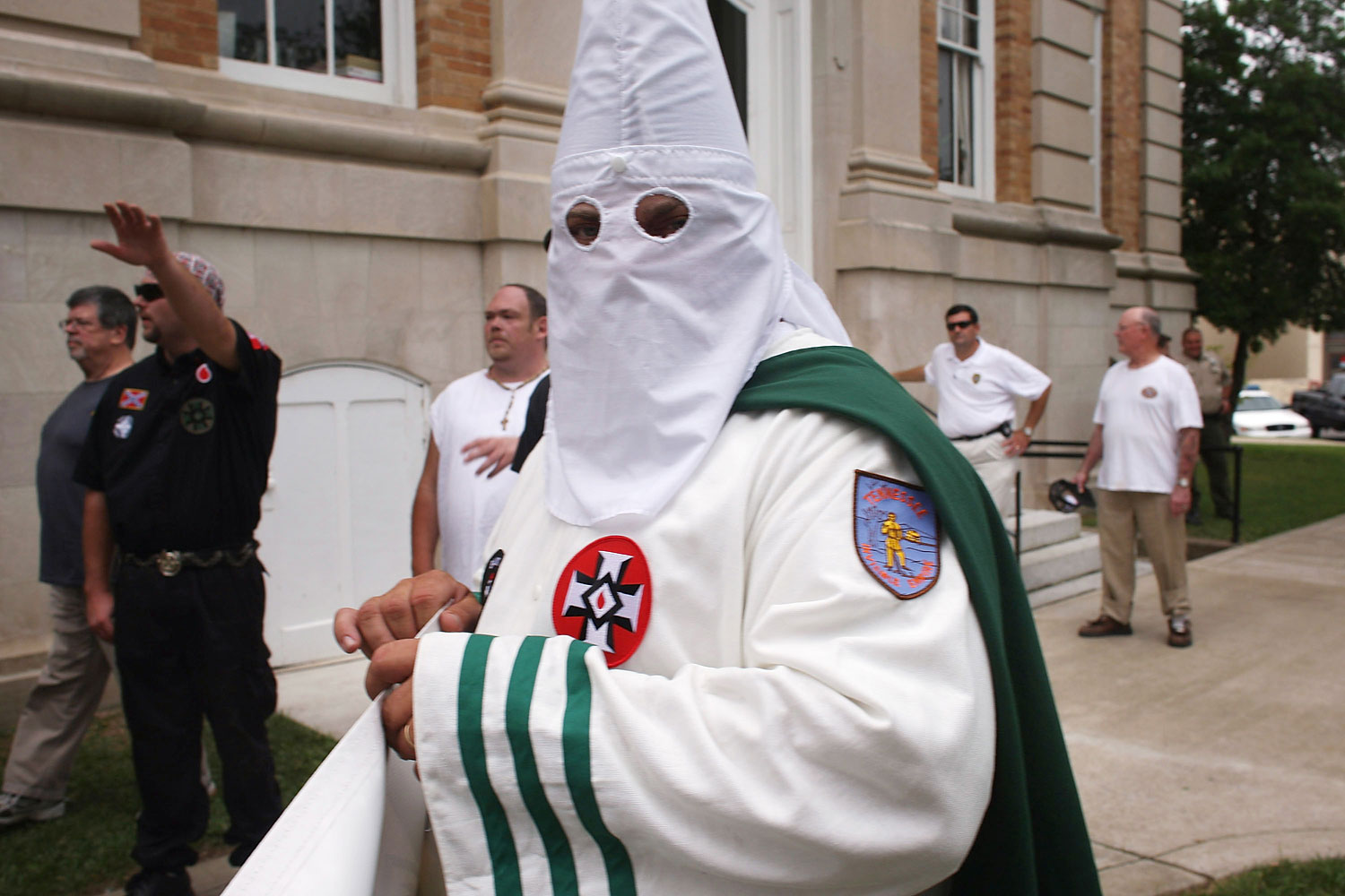 Members of the Fraternal White Knights of the Ku Klux Clan participate in the 11th Annual Nathan Bedford Forrest Birthday march July 11, 2009 in Pulaski, Tennessee.