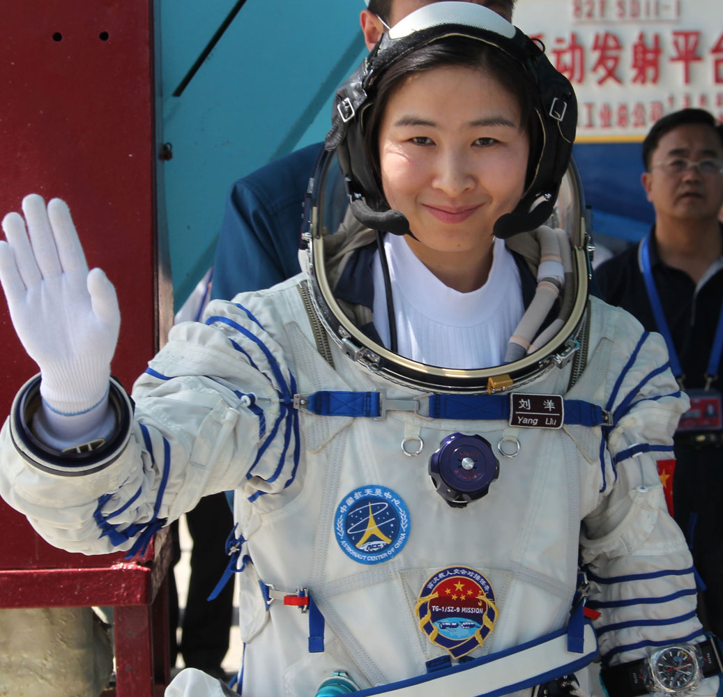 Chinese astronaut Liu Yang waves as she attends a drill in Jiuquan, northwest China's Gansu Province, on July 27, 2012. On June 16, 2012, Yang became China's first woman in space.