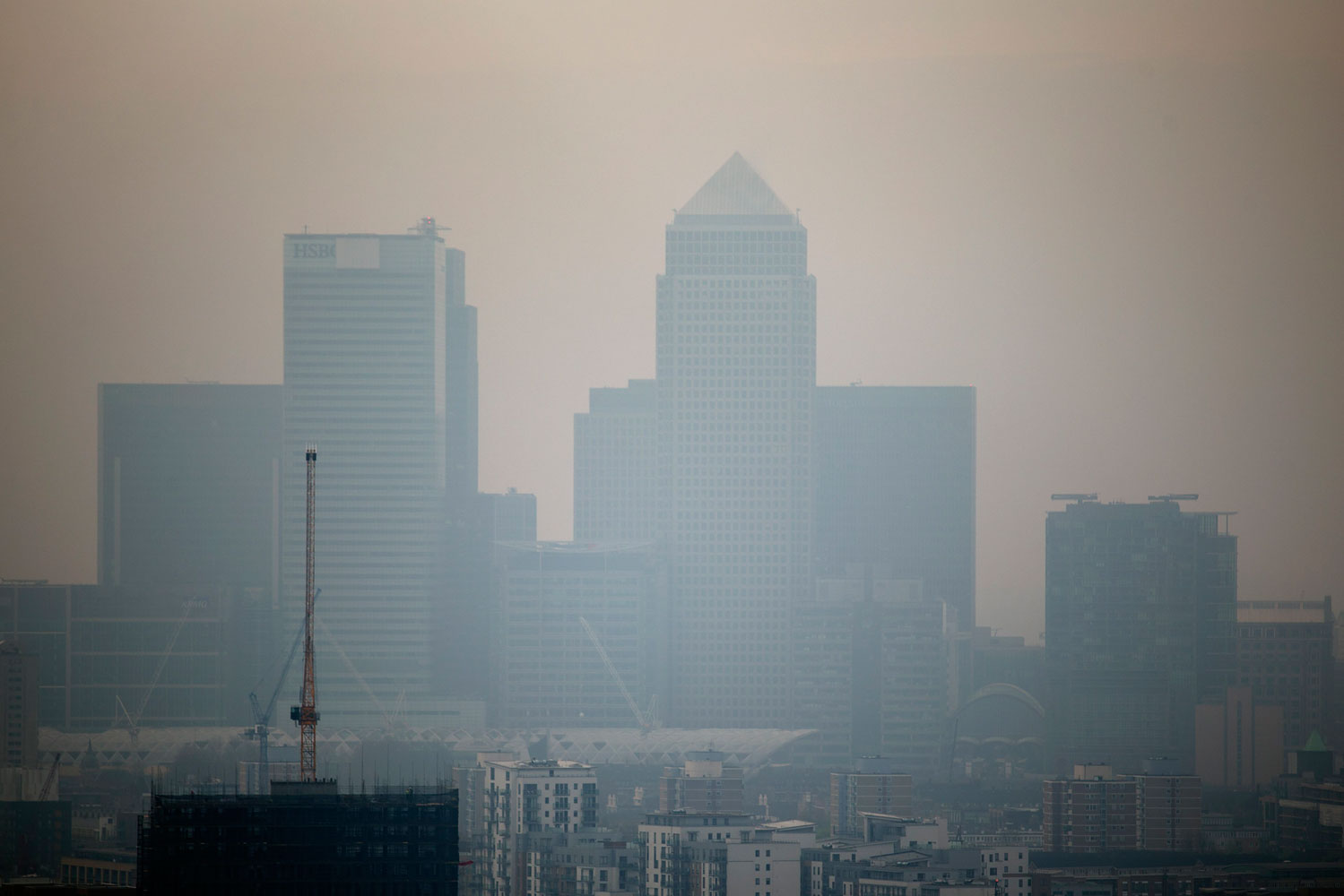 The skyscrapers of the Canary Wharf business district in London are shrouded in smog, April 2, 2014.