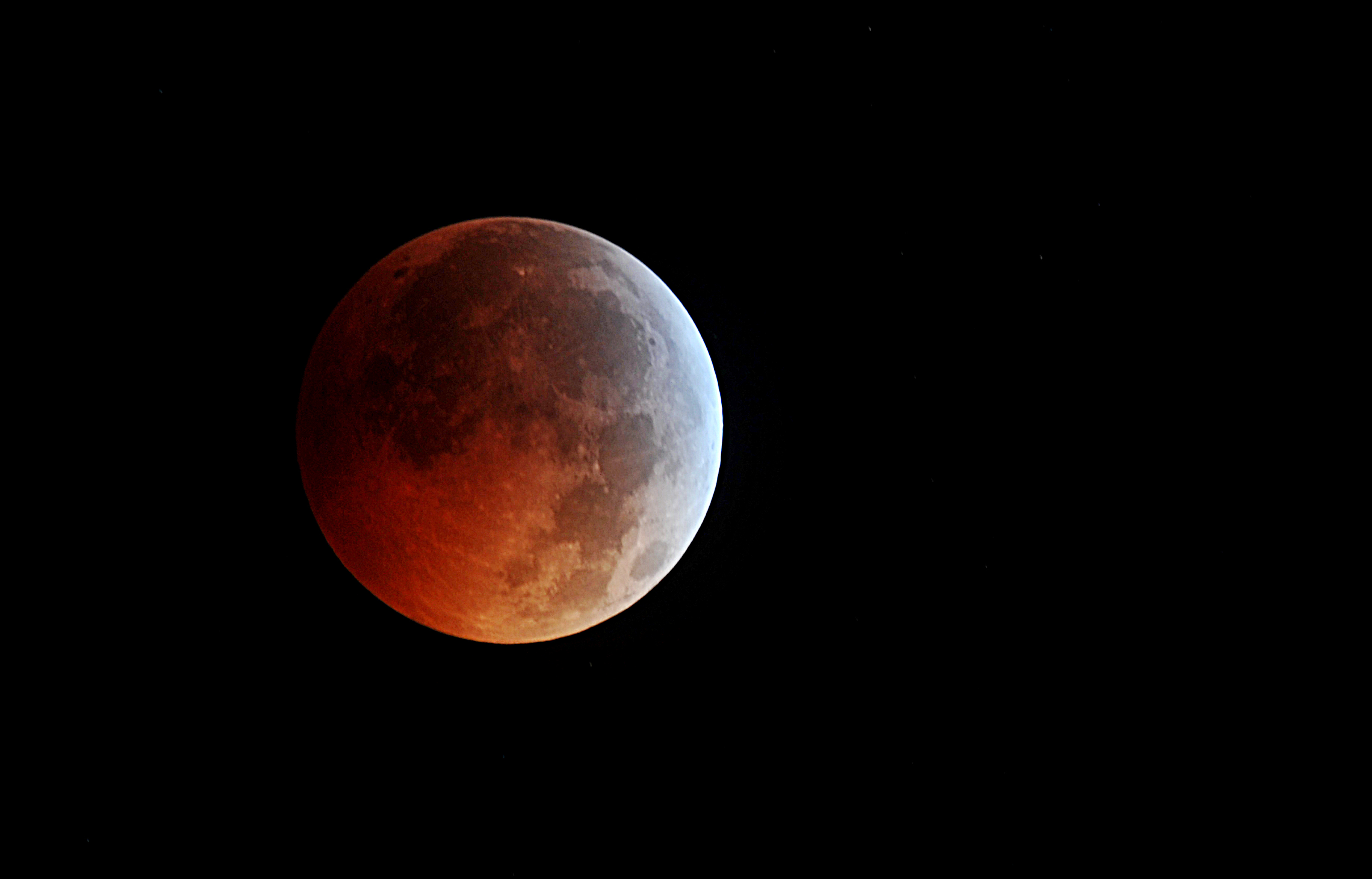 Lights out: a blood moon as a total lunar eclipse reaches its peak