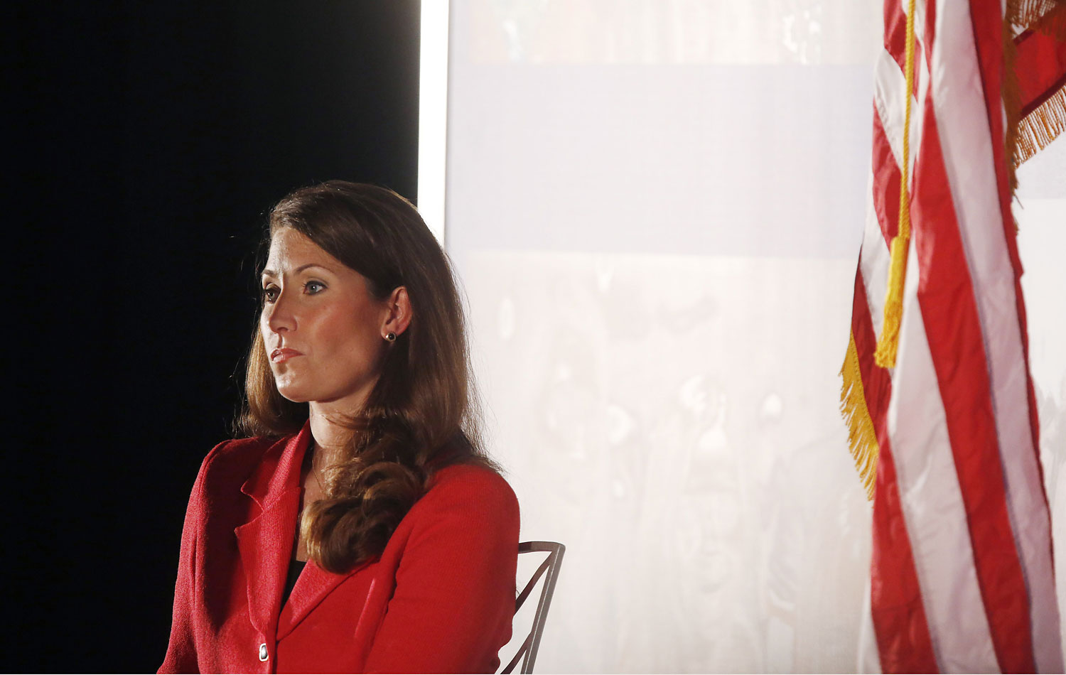 Kentucky Democratic Senate Candidate Alison Lundergan Grimes listens as Former President Bill Clinton delivers remarks during a campaign event at the Galt House Hotel on Tuesday, Feb. 25, 2014 in Louisville, Ky.