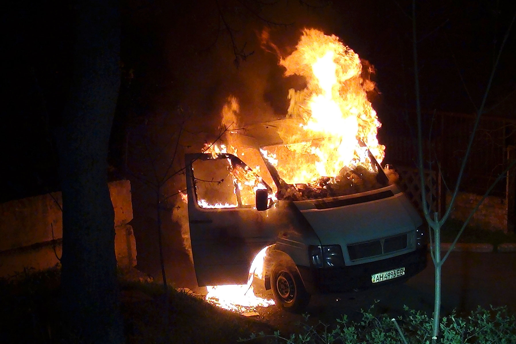 A minivan burns at the gates to a National Guard base in Mariupol, early Thursday, April 17, 2014