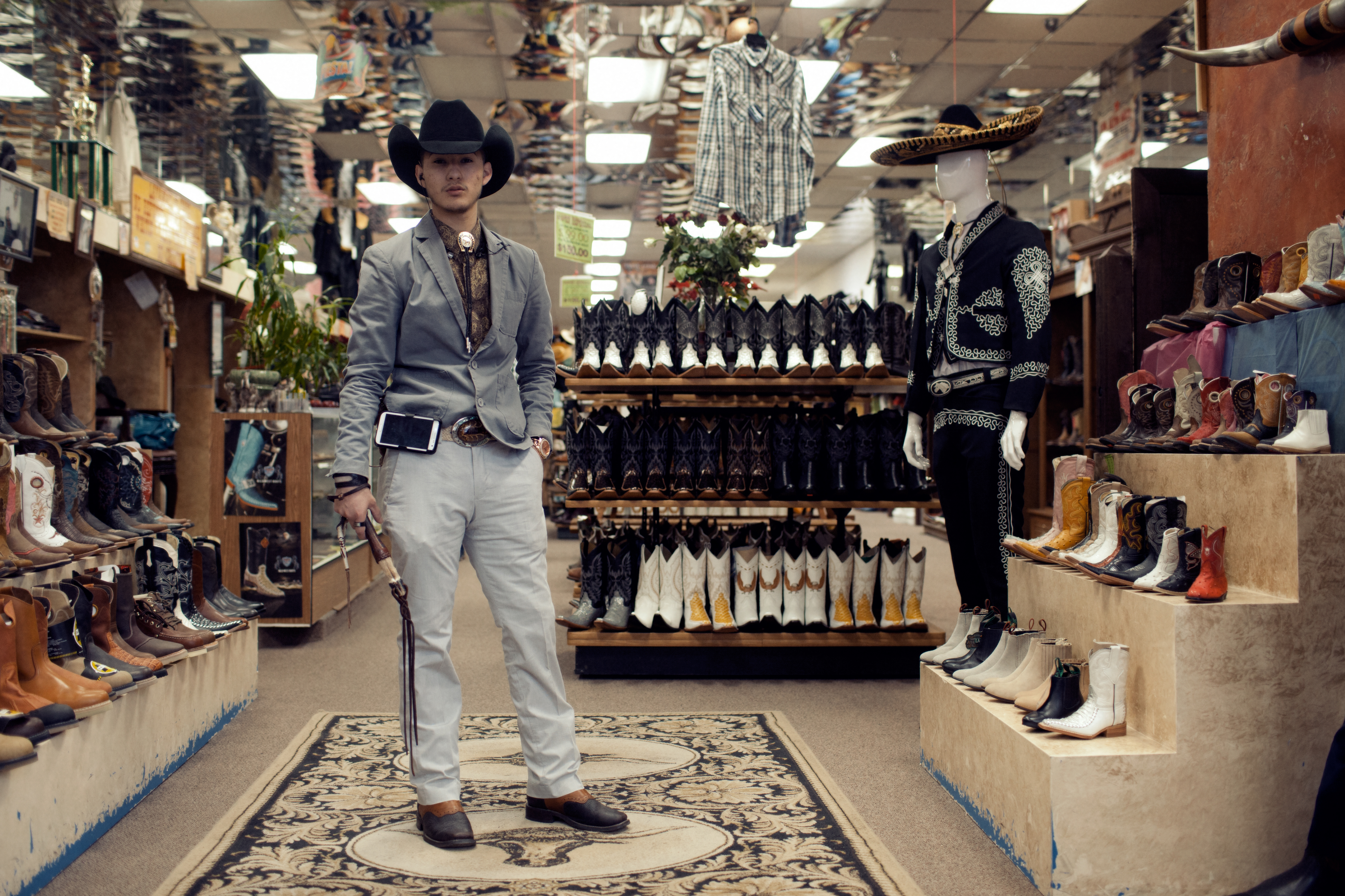 A portrait of Jorge Barraza, 19, from Long Beach, Calif., who works at a store specialising in Western wear. Jorge has spent time in both the U.S. and in Durango, Mexico, where his family is originally from.