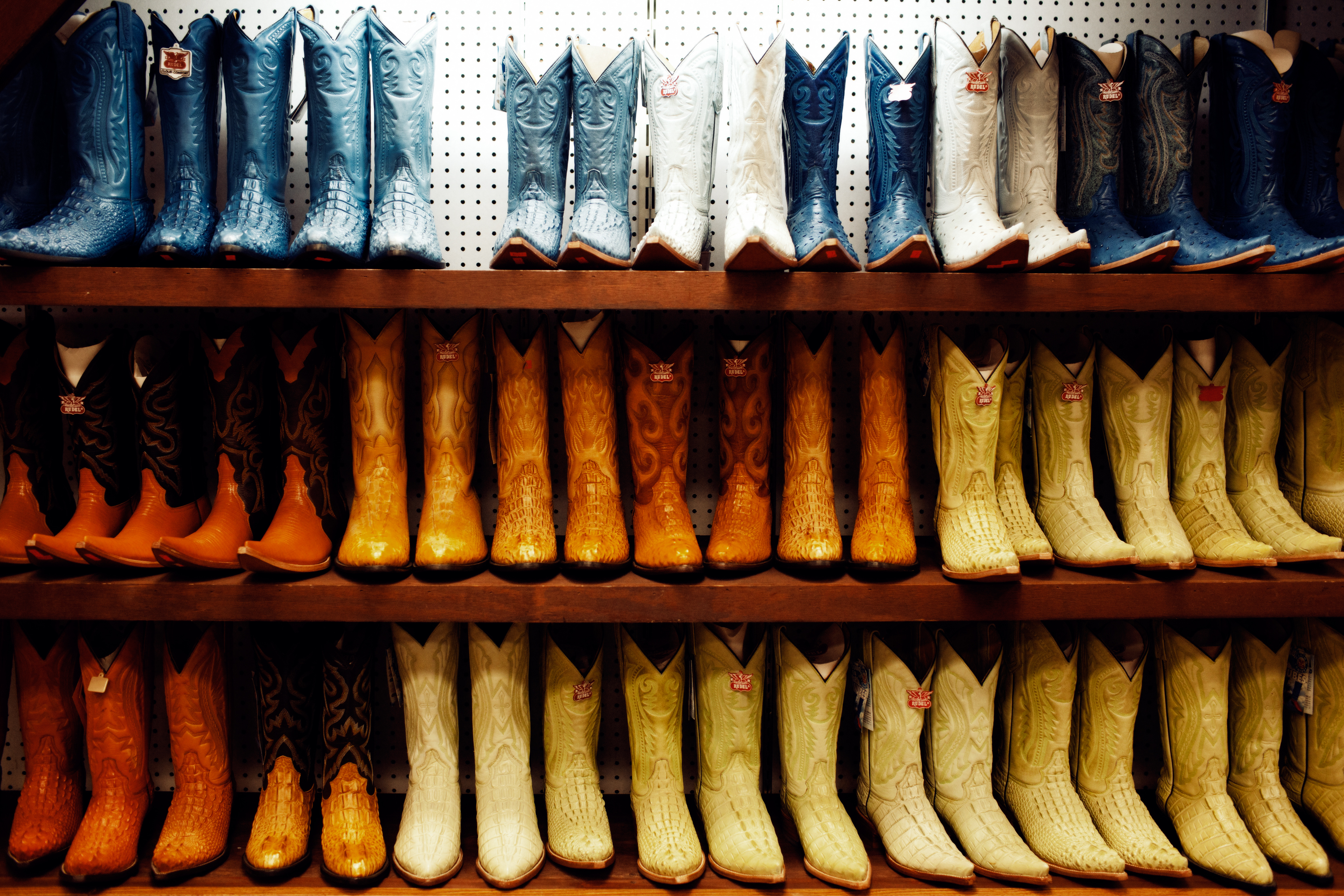 Colorful cowboy boots are lined up for sale at La Gran Plaza.