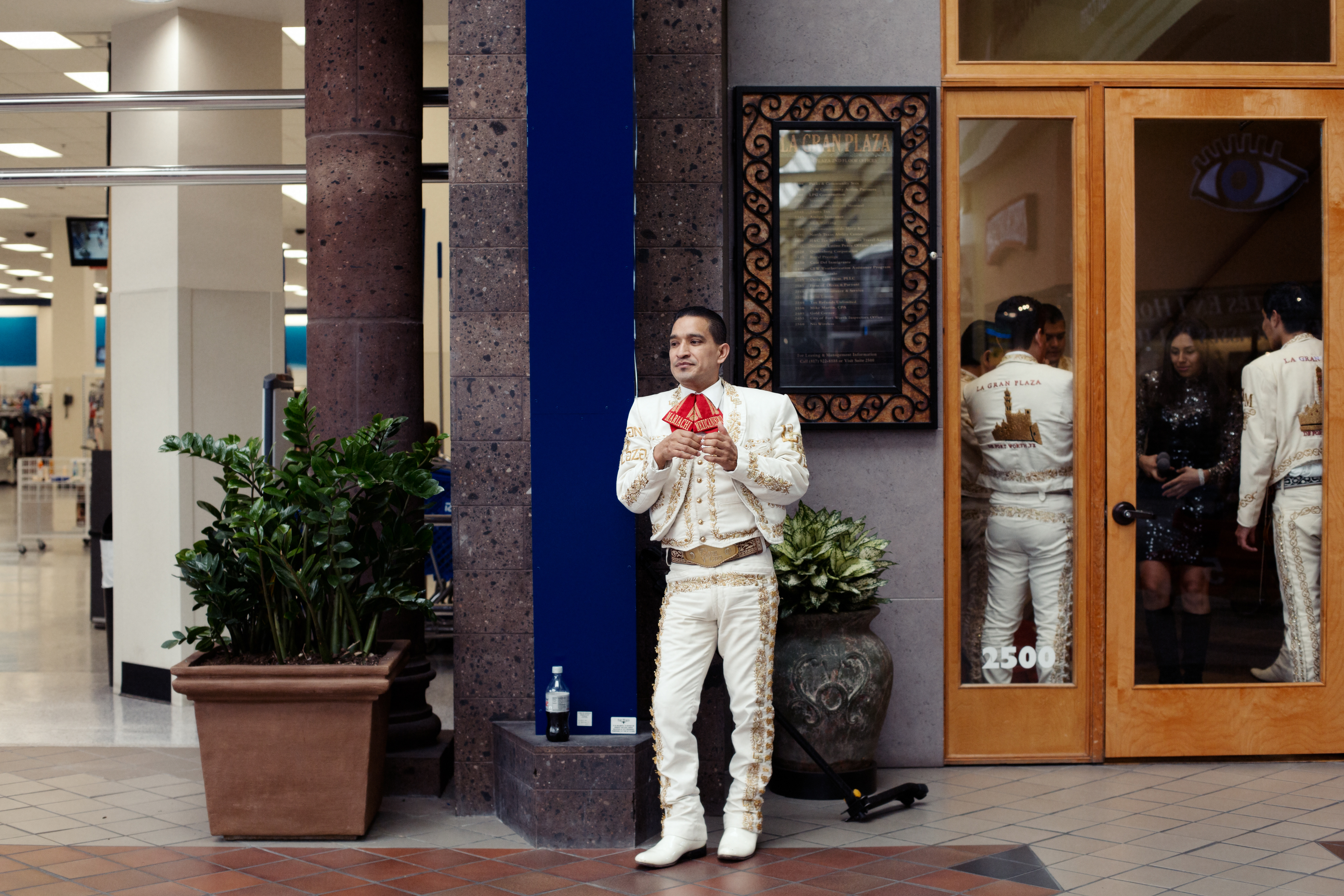 A mariachi stands outside La Gran Plaza mall. The mariachi outfits are custom made for the mall.