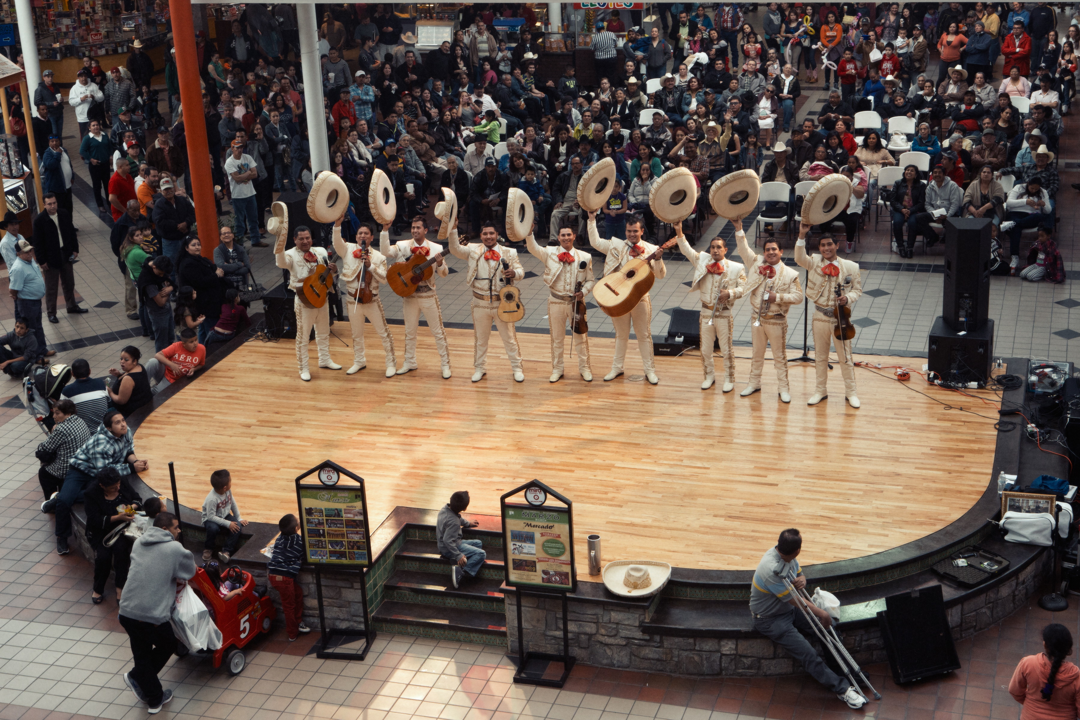Mariachis start their performance for a packed audience.