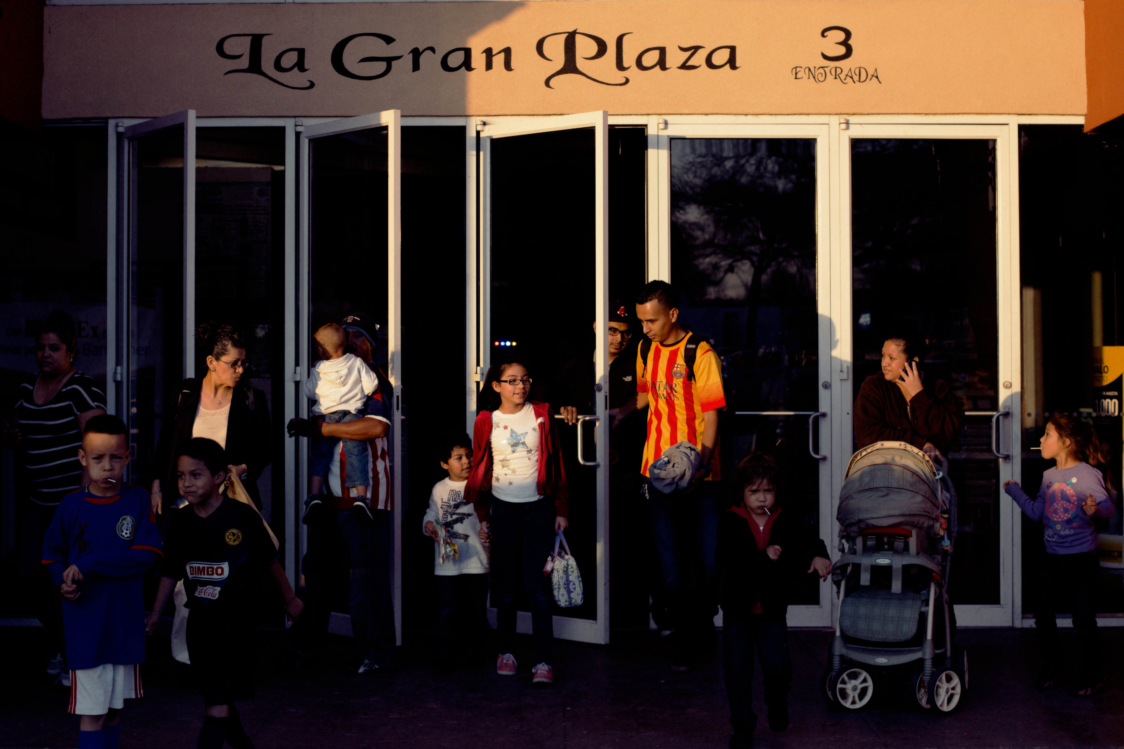 Shoppers leave La Gran Plaza at the end of a busy Sunday. Focus on a fun, family atmosphere with a flavor of the Mexican  mercado  have made the turnaround a huge success.
