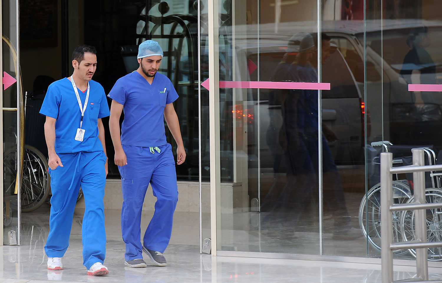 Saudi medical staff leave the emergency department at a hospital in the center of the Saudi capital Riyadh on April 8, 2014.