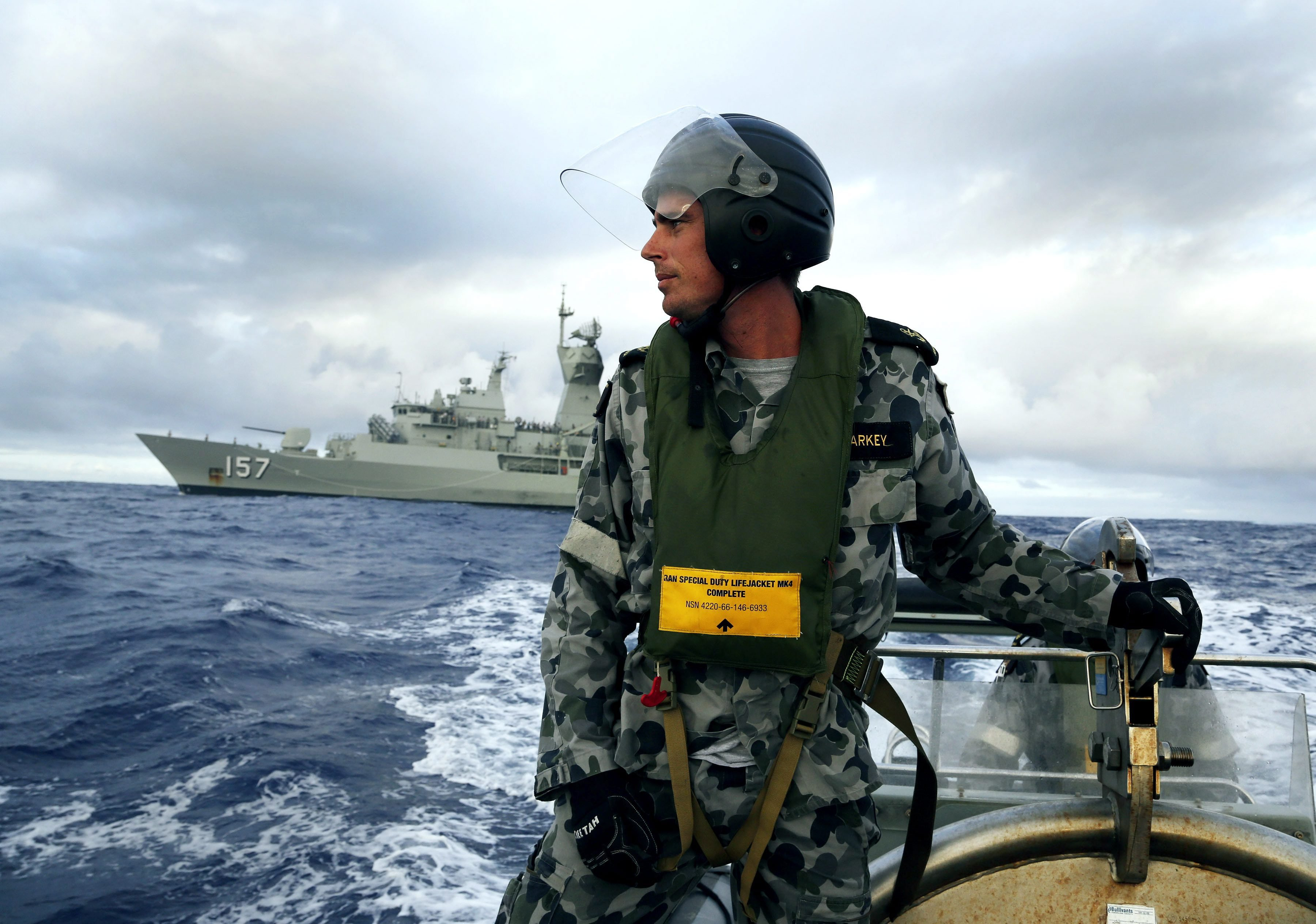 Leading Seaman, Boatswain's Mate, William Sharkey searching for debris in the Southern Indian Ocean on April 6, 2014.