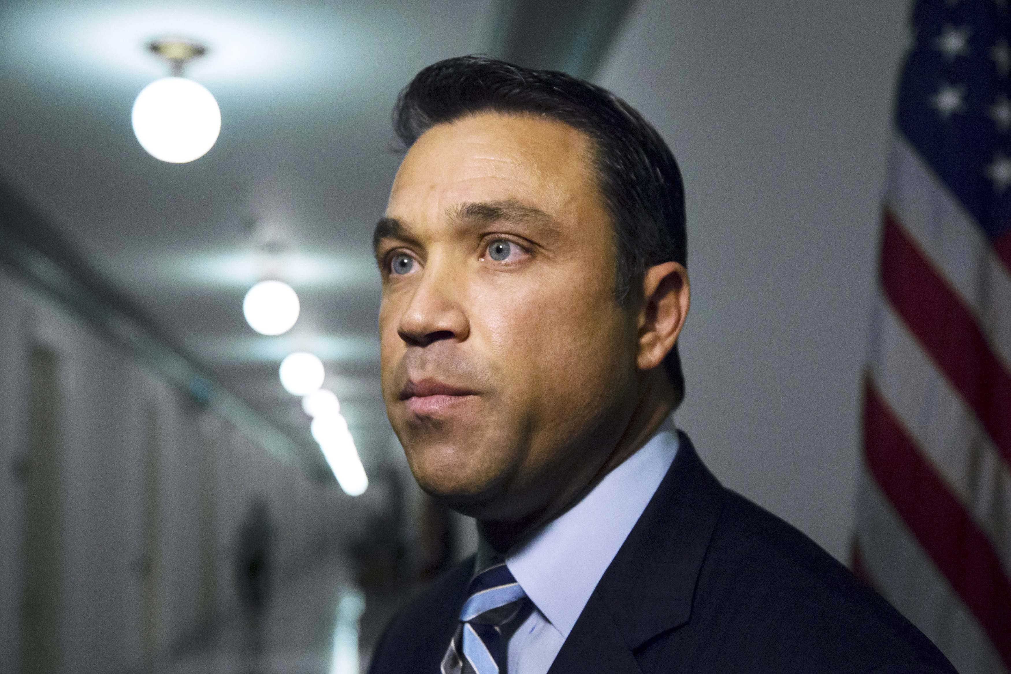 U.S. Representative Michael Grimm (R-NY) talks to reporters outside his office on Capitol Hill in Washington April 29, 2014.