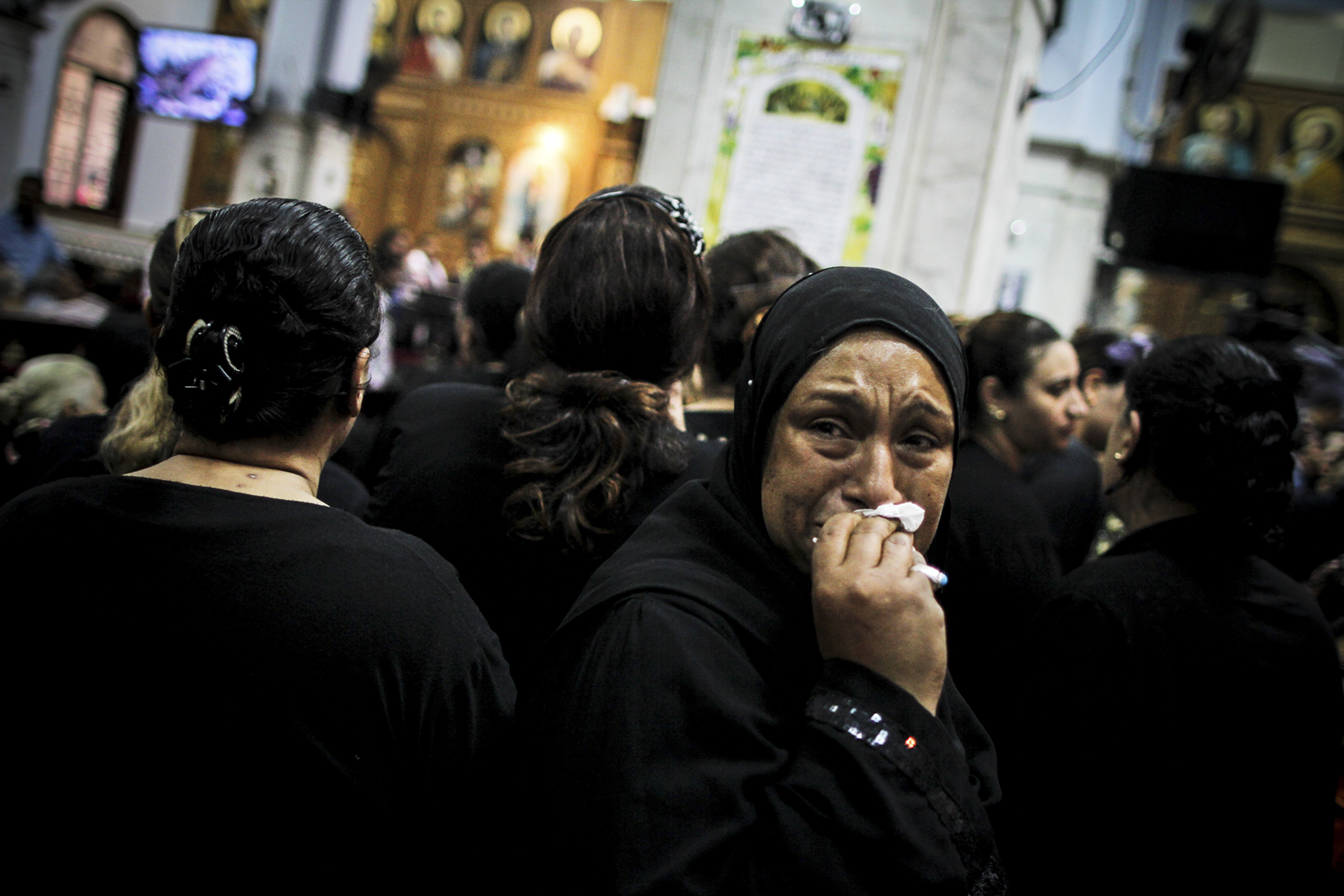 Escalating fear A mourner at the funeral of four Egyptian Christians killed in a drive-by shooting