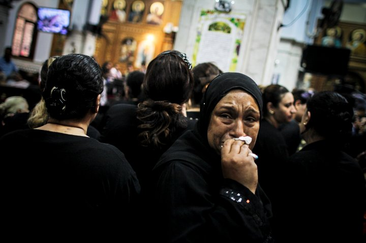 A mourner at the funeral of four Egyptian Christians killed in a drive-by shooting