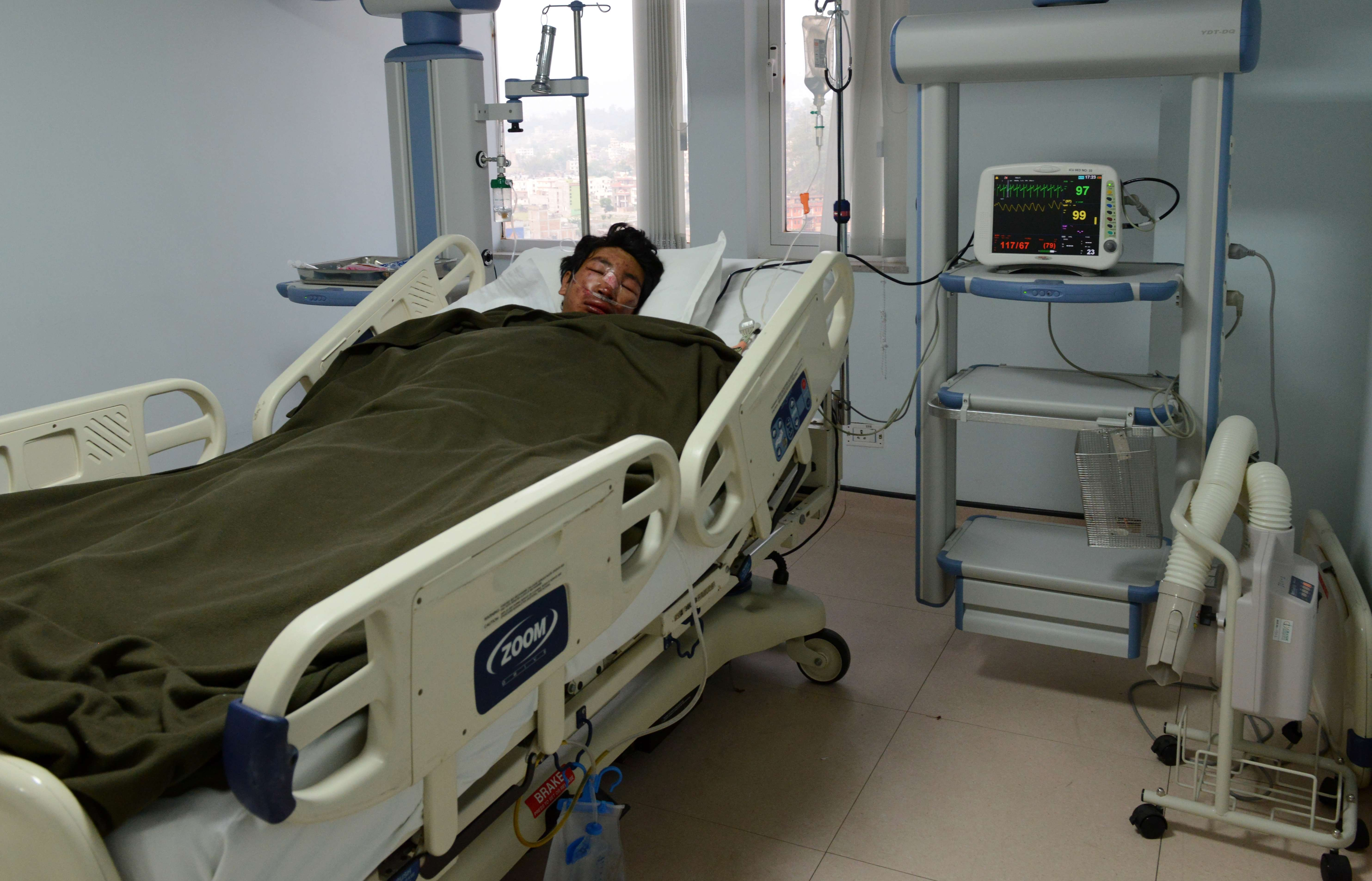 Nepalese mountaineer, Dawa Tashi Sherpa, survivor of the avalanche on Mount Everest, lies in the Intensive Care Unit (ICU) at Grandi International Hospital in Kathmandu on April 18, 2014.