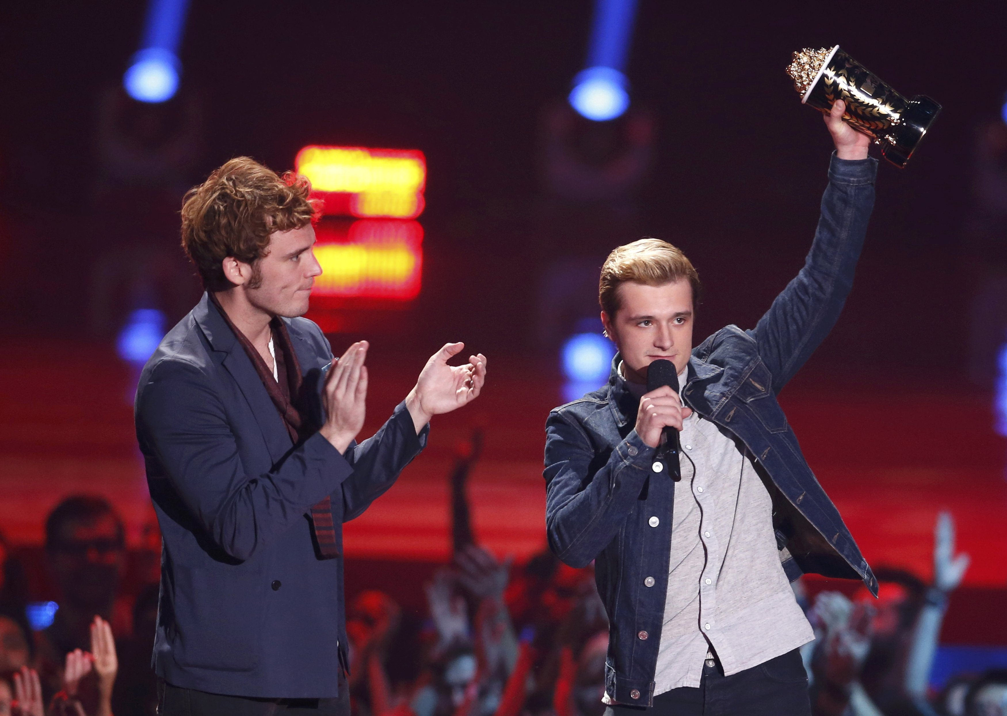 From left: Sam Claflin and Josh Hutcherson accept the award for Best Movie of the Year for  The Hunger Games: Catching Fire  at the 2014 MTV Movie Awards in Los Angeles, on April 13, 2014.