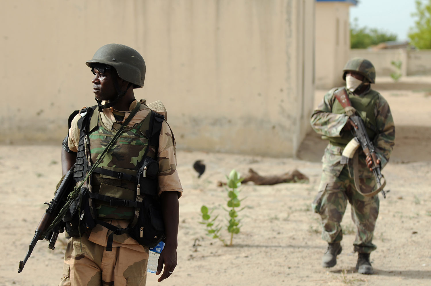 Nigerian soldiers patrol in the north of Borno state close to a Islamist extremist group Boko Haram former camp on June 5, 2013 near Maiduguri.