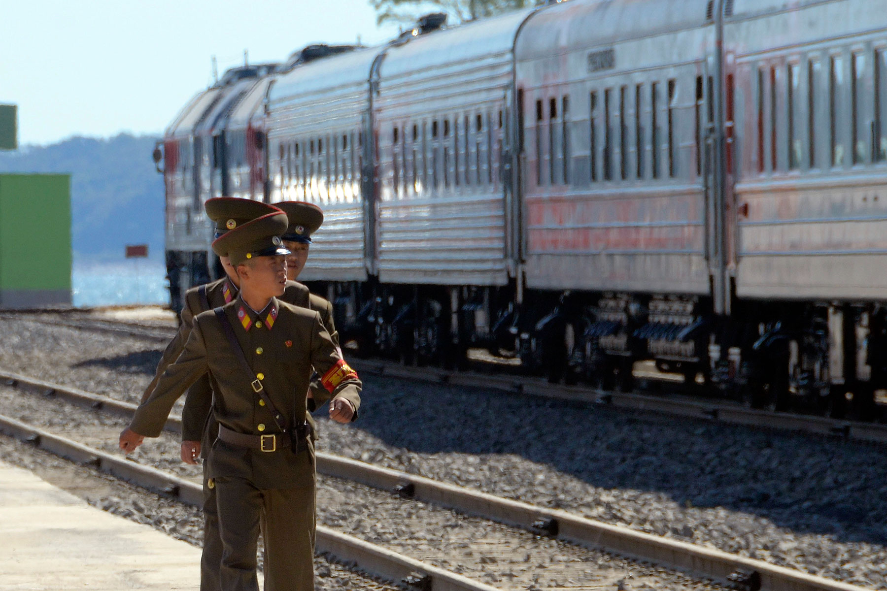 North Korean soldiers march near trains after a ceremony to mark the re-opening of a railway link between Russia and North Korea at the port of Rajin Sept. 22, 2013