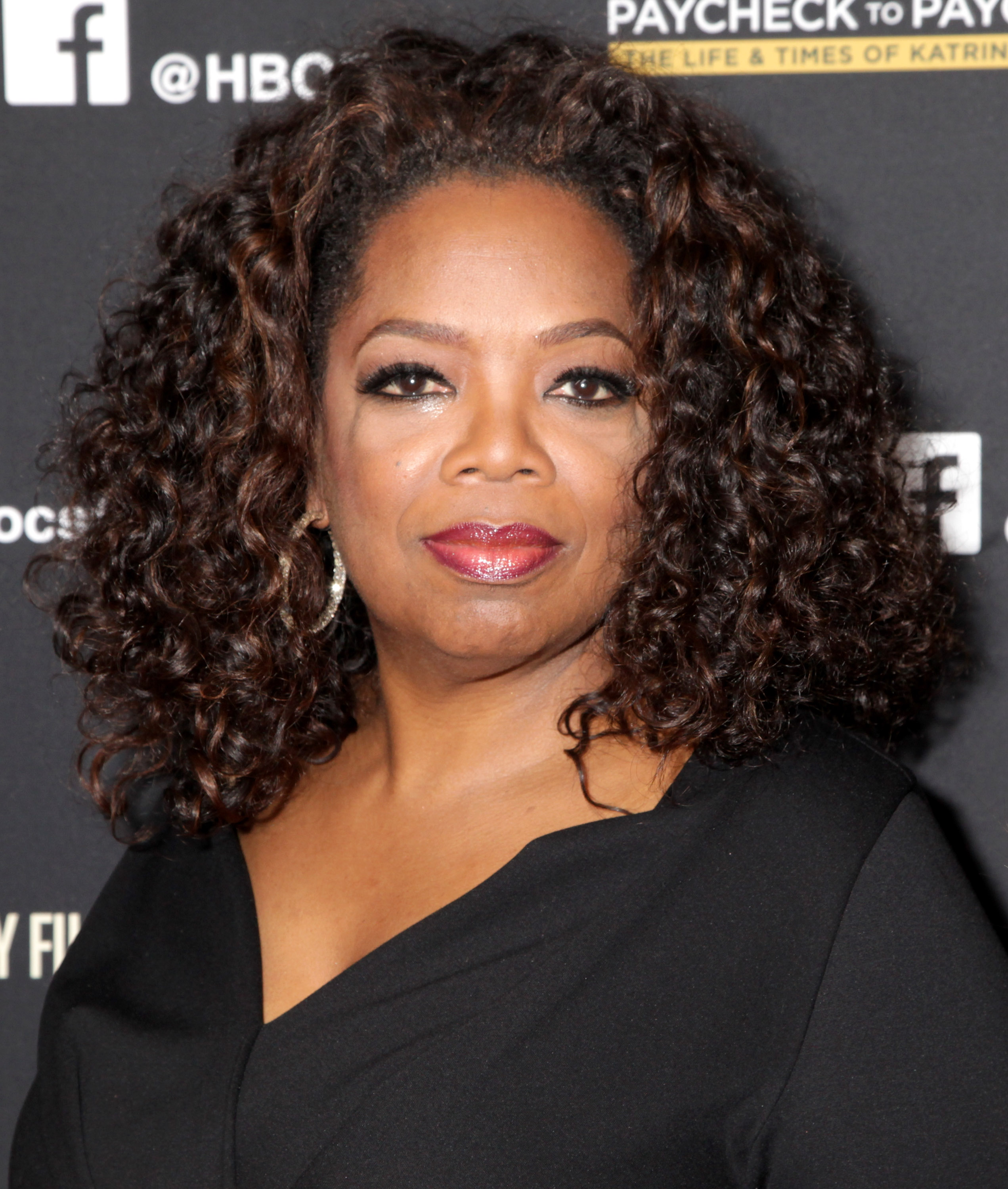 Oprah attends the Los Angeles premiere of HBO Documentary Films  Paycheck To Paycheck  at the Linwood Dunn Theater at the Pickford Center for Motion Study on March 10, 2014 in Hollywood, California.