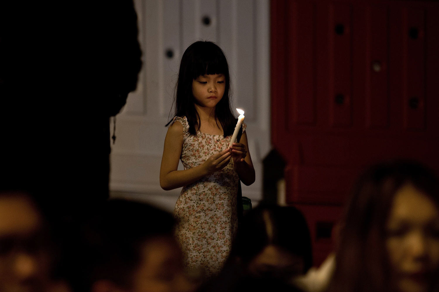 Apr. 8, 2014. A Malaysian girl takes part in a candle-light vigil to mark the one-month anniversary of the missing Malaysia Airlines MH370 flight at the Independence Square in Kuala Lumpur.