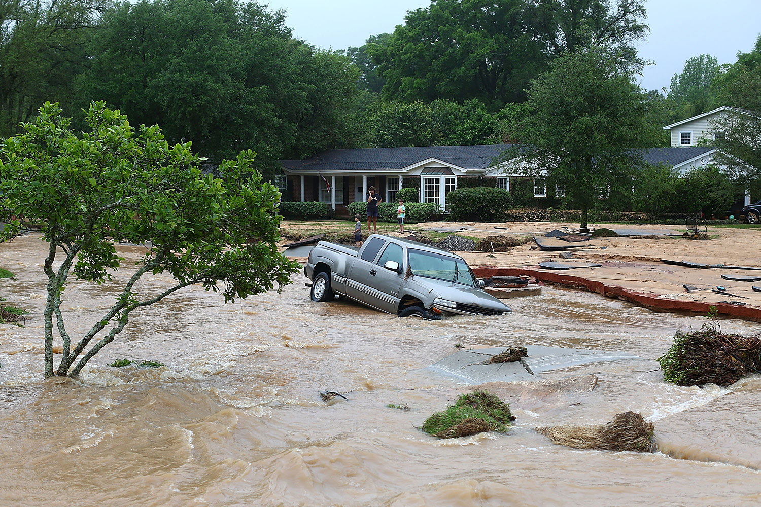 A truck is stuck in the middle of flooded Piedmont Street in the Cordova Park neighborhood after it washed out due to heavy rains on April 30, 2014 in Pensacola, Fla.