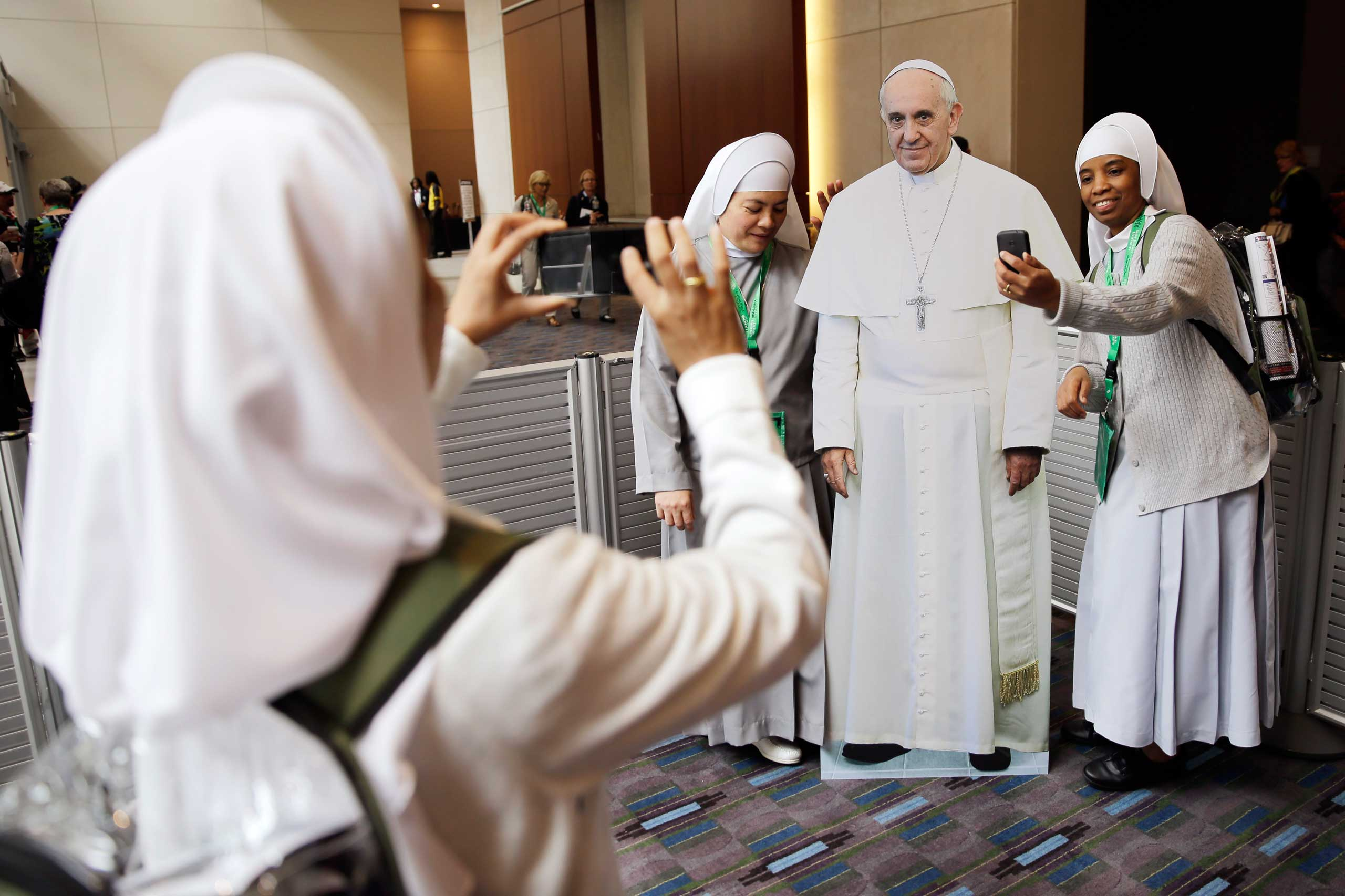 Nuns with the Hospitaler Sisters of Mercy in Pleasantville, N.J., pose for a selfie with a cutout of Pope Francis, at the World Meeting of Families conference, in Philadelphia, on Sept. 22, 2015.