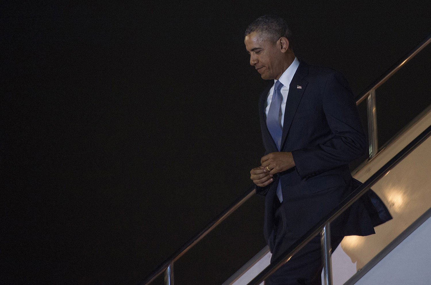 President Obama walks off Air Force One as he arrives at Haneda Airport in Tokyo, on April 23, 2014.