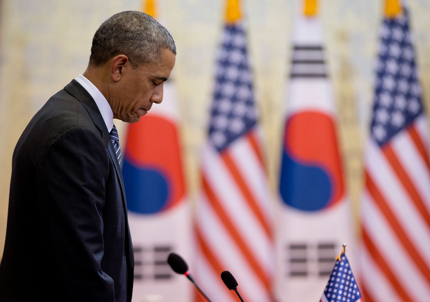 President Obama pauses for a moment of silence for those who died in the ferry disaster as Obama and South Korean President Park Geun-hye, participate in the bilateral meetings at the Blue House, April 25, 2014, in Seoul.
