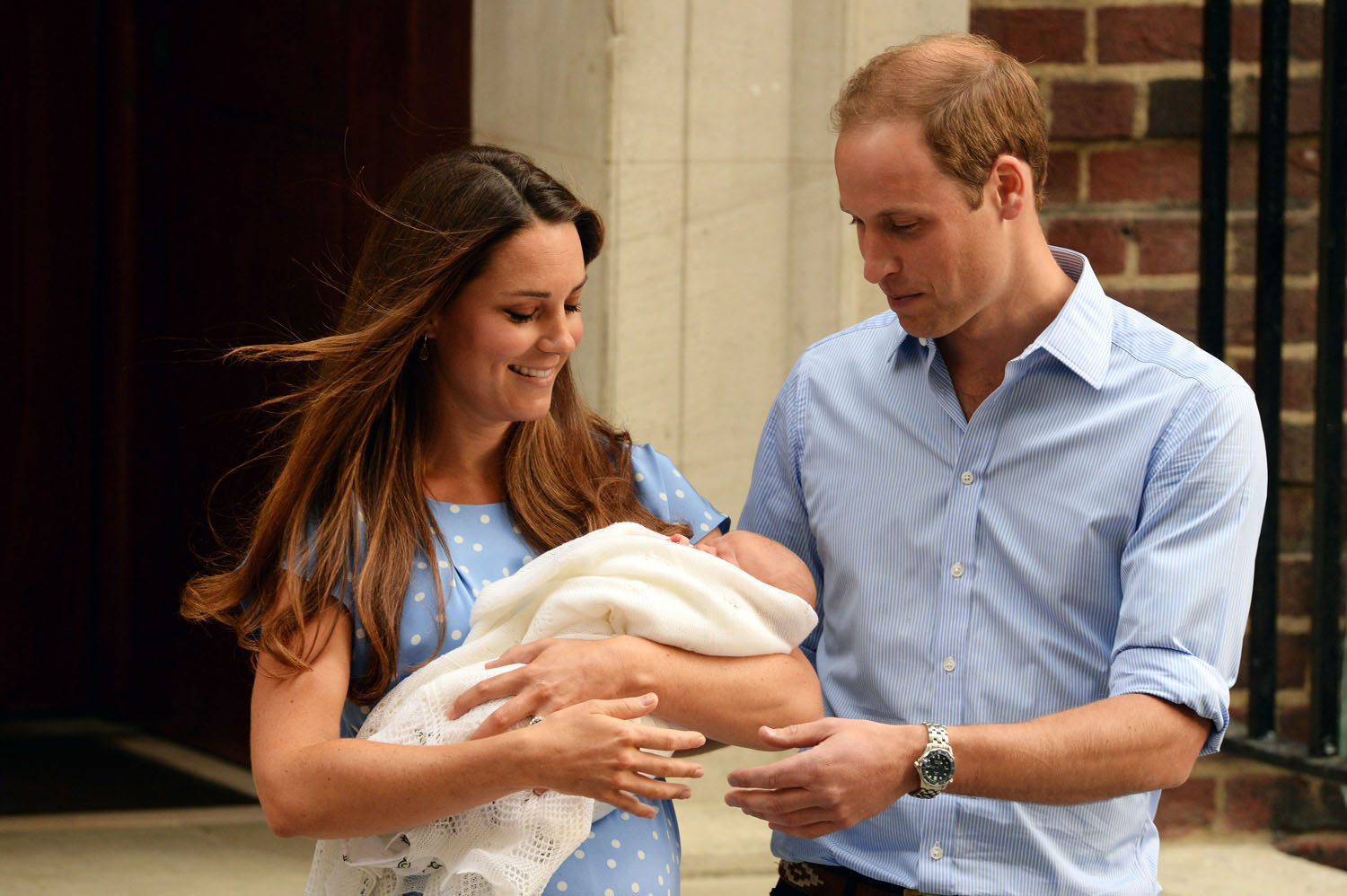 Prince William, Duke of Cambridge and Catherine, Duchess of Cambridge, depart The Lindo Wing with their newborn son, Prince George, at St Mary's Hospital in London on July 23, 2013.