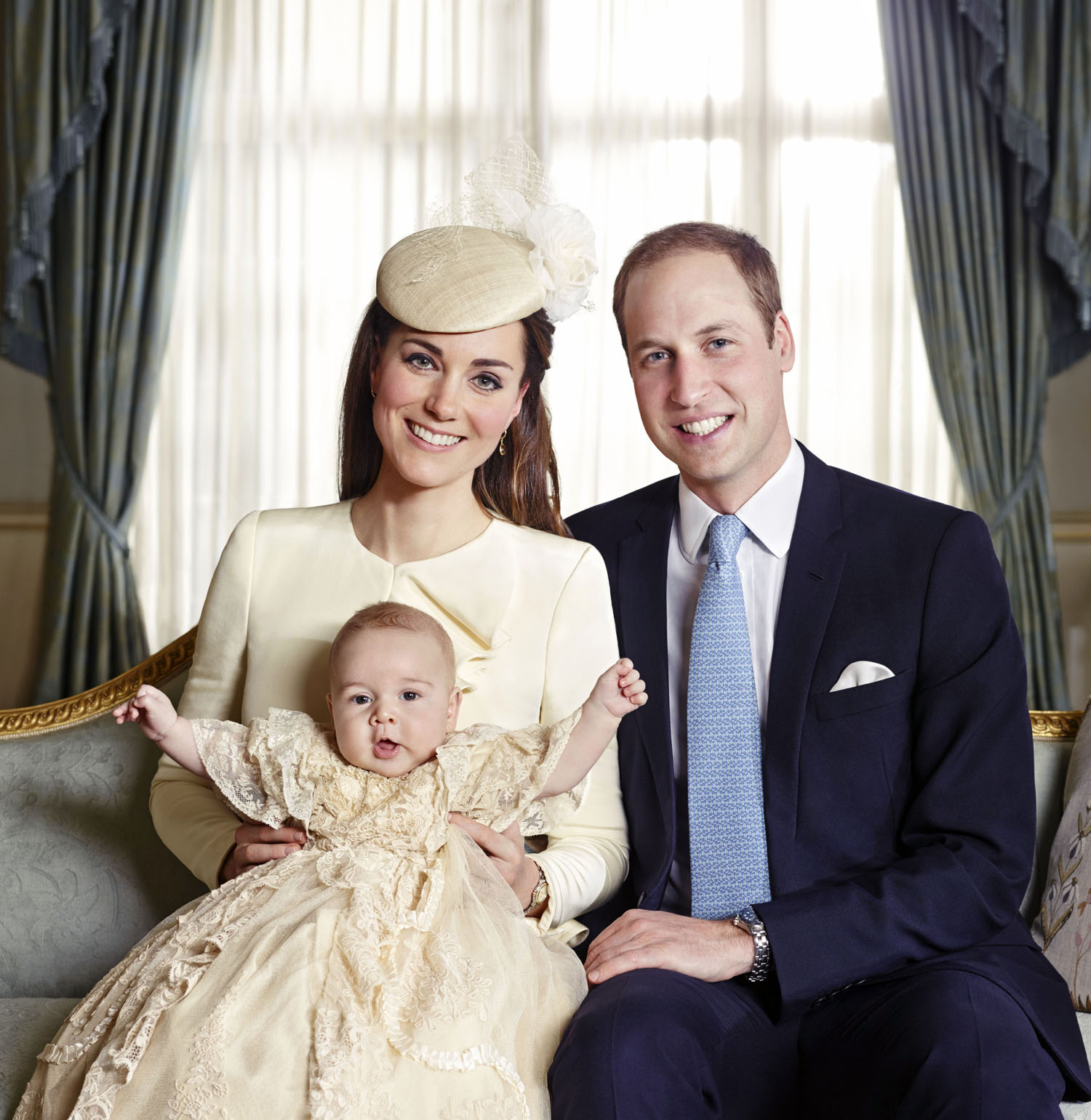 The official portrait for the christening of Prince George Alexander Louis of Cambridge, photographed at Clarence House in London on October 23, 2013. Prince George wears an outfit made of delicate Honiton lace and white satin - an exact replica of the one worn before him by every baby born to the British Royal family since 1841.