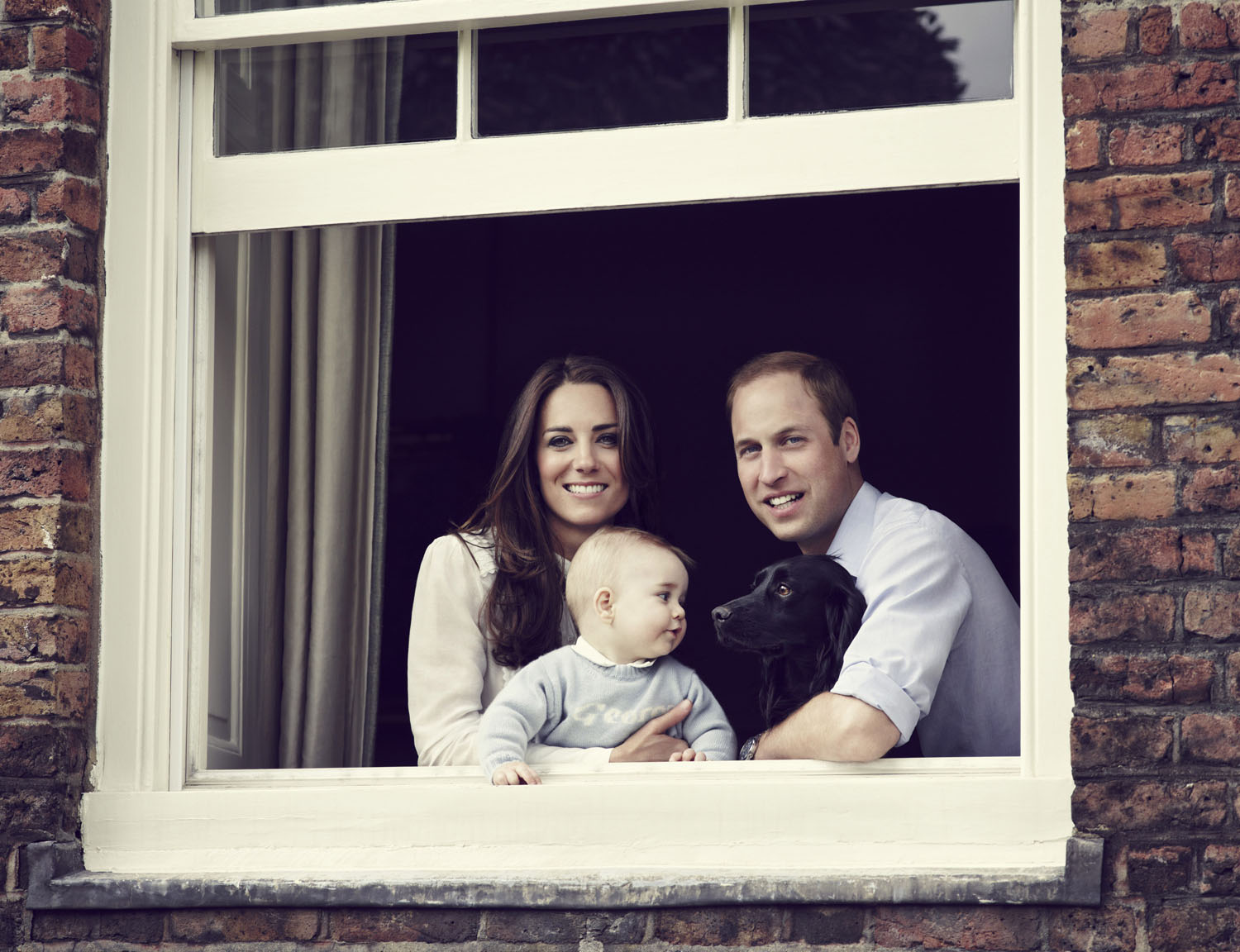 Prince William, Duke of Cambridge, Catherine, Duchess of Cambridge and Prince George of Cambridge pose for an official family portrait at Kensington Palace, ahead of their tour to Australia and New Zealand, with their pet dog Lupo on March 18, 2014 in London.