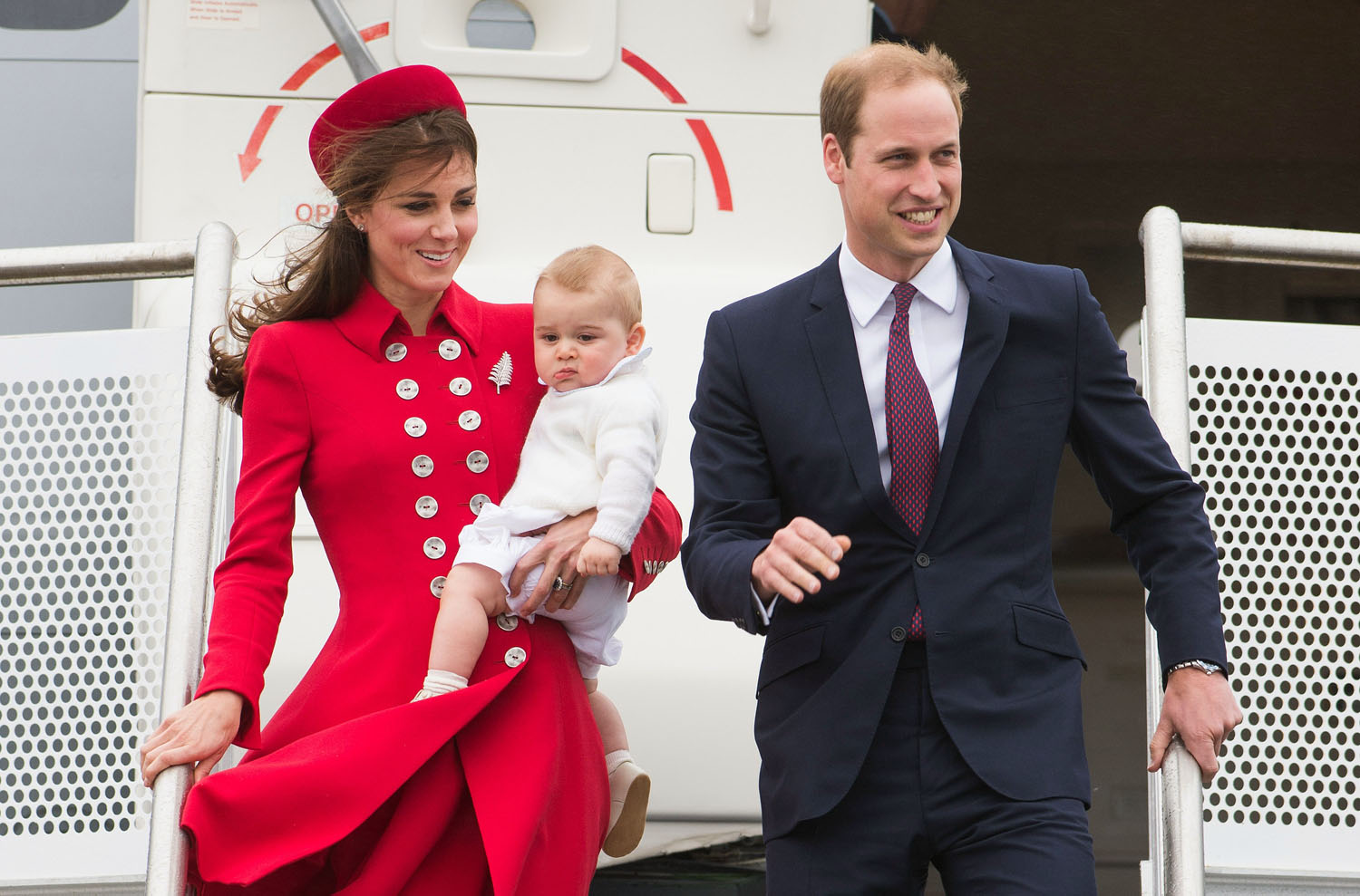 Prince William, Duke of Cambridge, Catherine, Duchess of Cambridge and Prince George of Cambridge arrive at Wellington Airport's military terminal for the start of their tour on April 7, 2014 in Wellington, New Zealand.
