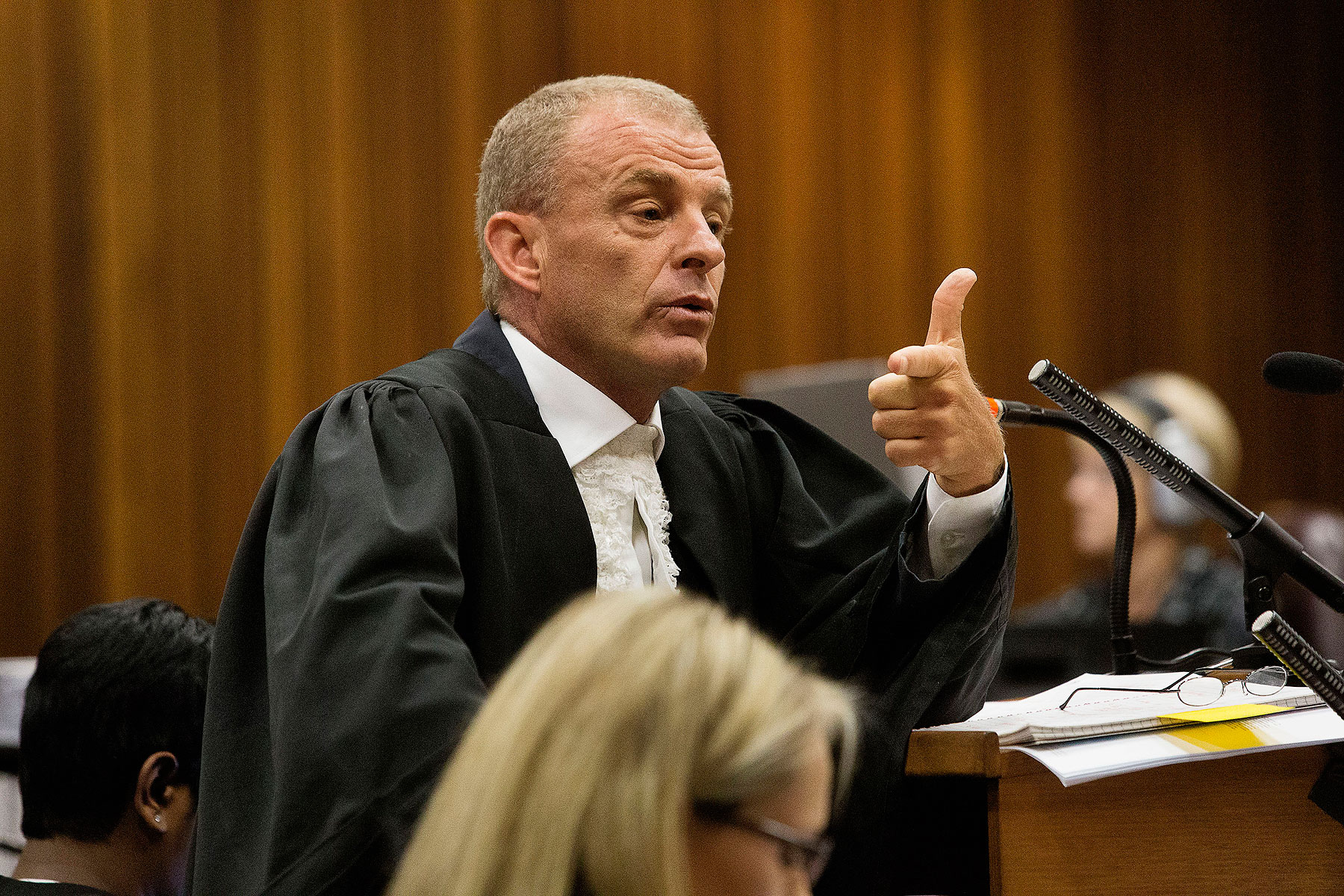 State prosecutor Gerrie Nel gestures as he cross examines Oscar Pistorius during his ongoing murder trial in Pretoria, April 10, 2014