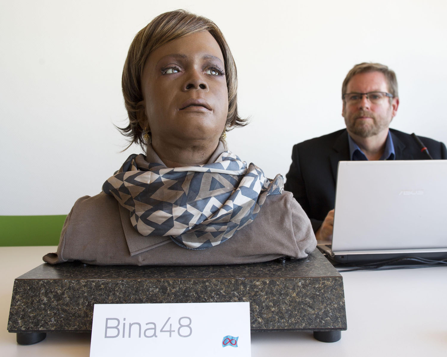 Bina48 talks to her designing engineer Bruce Duncan at a press date in Wetzlar, Germany, March 15, 2013.