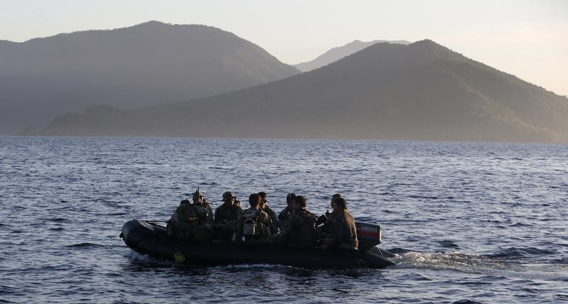 Philippine marines sail among the Spratly Islands on March 31, 2014.  In June, a 40-strong delegation will visit their Vietnamese counterparts for a beach party