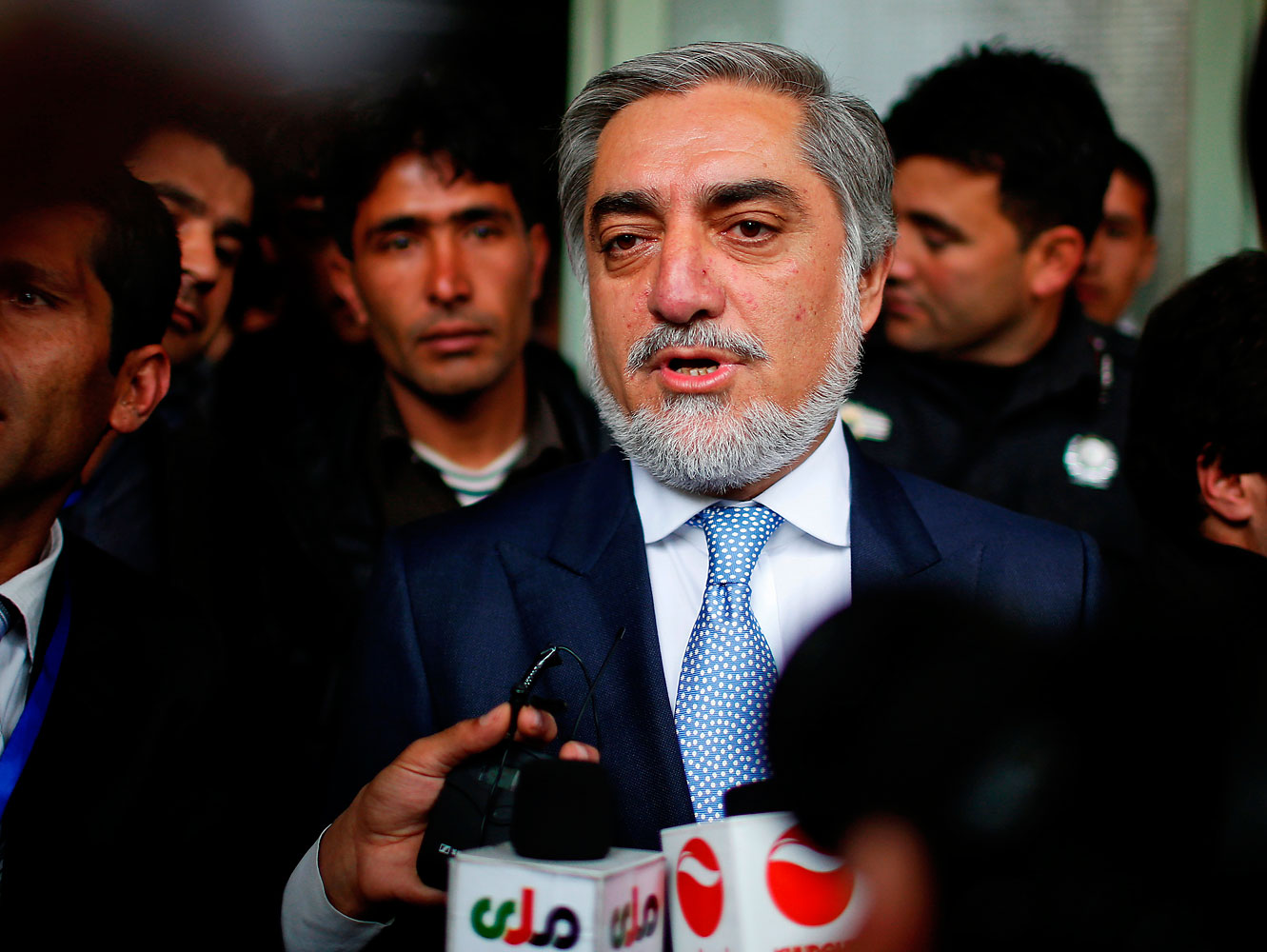 Afghan presidential candidate Abdullah Abdullah speaks to the media after voting at a polling station in Kabul on April 5, 2014