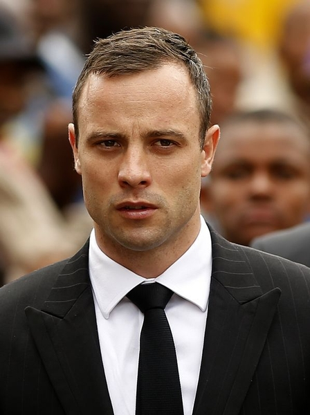Olympic athlete Oscar Pistorius arrives ahead of his third day at the witness stand in the court in Pretoria on April 9, 2014.