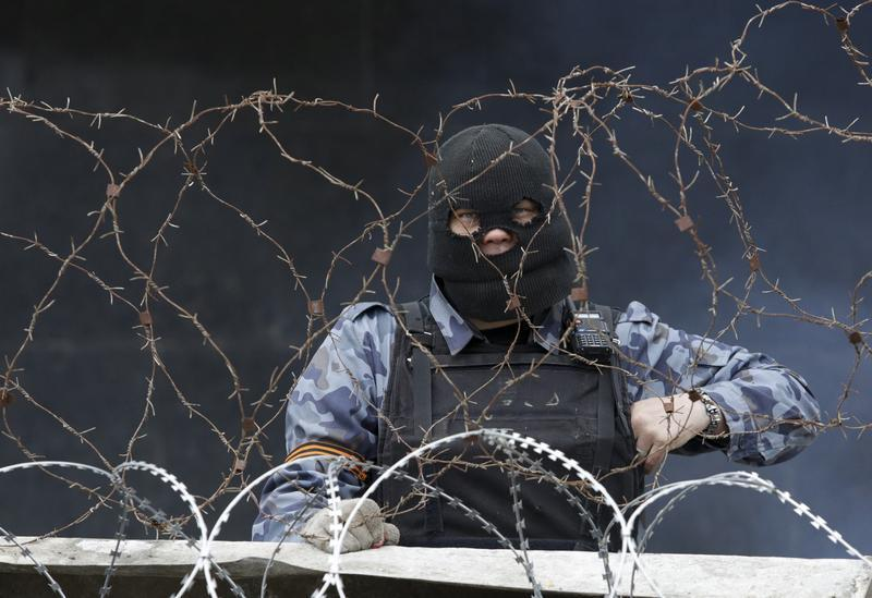 A pro-Russian protester mans a barricade outside a government building in Donetsk.