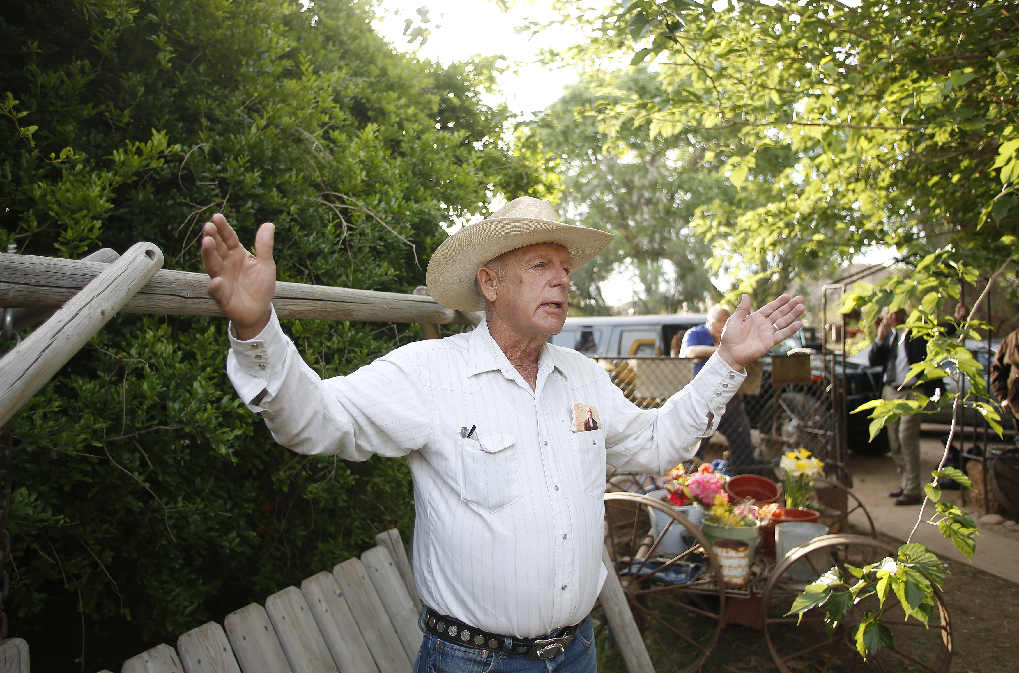 Rancher Cliven Bundy gestures at his home in Bunkerville, Nevada April 12, 2014. He has called on sheriffs to join him in a quixotic crusade to disarm the Federal government