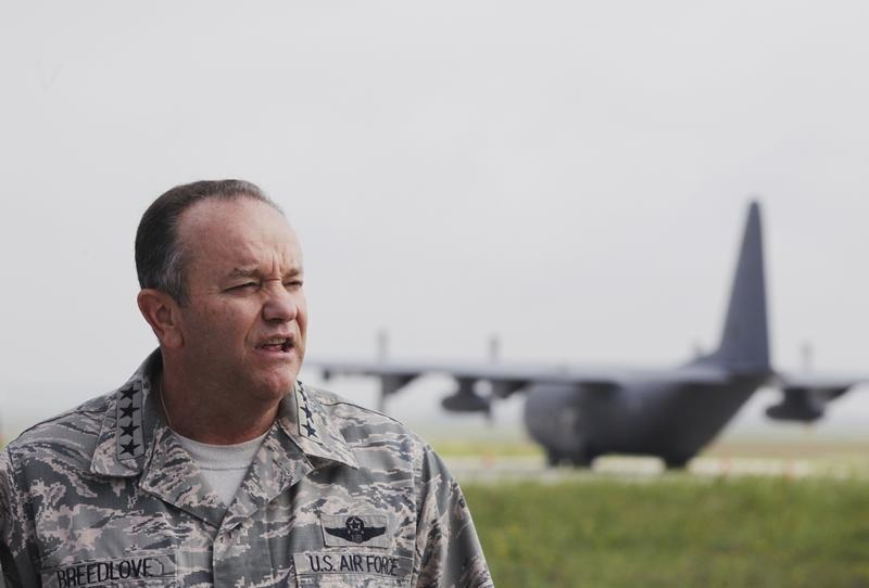 NATO's top military chief, General Philip Breedlove, warned that the threat from Russian troops located within striking distance of Ukraine's border is very potent. Here he is seen at the Pristina Military Airport June 7, 2013.