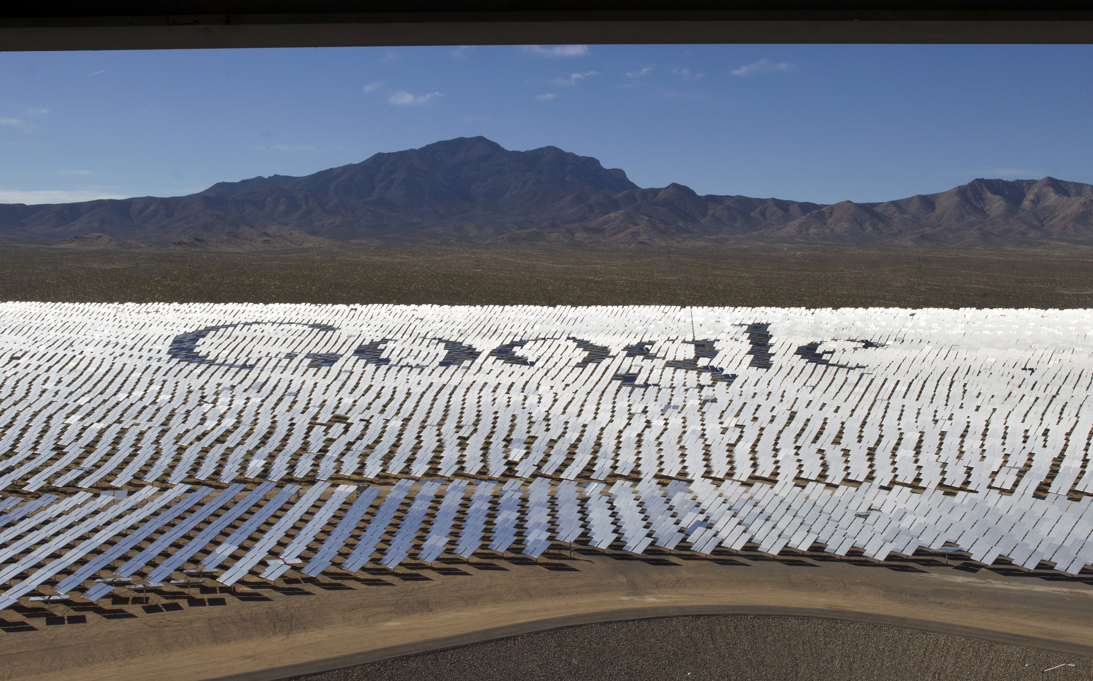 The Google logo is spelled out in heliostats (mirrors that track the sun and reflect the sunlight onto a central receiving point) during a tour of the Ivanpah Solar Electric Generating System in the Mojave Desert near the California-Nevada border February 13, 2014. The project, a partnership of NRG, BrightSource, Google and Bechtel, is the world's largest solar thermal facility and uses 347,000 sun-facing mirrors to produce 392 Megawatts of electricity, enough energy to power more than 140,000 homes.