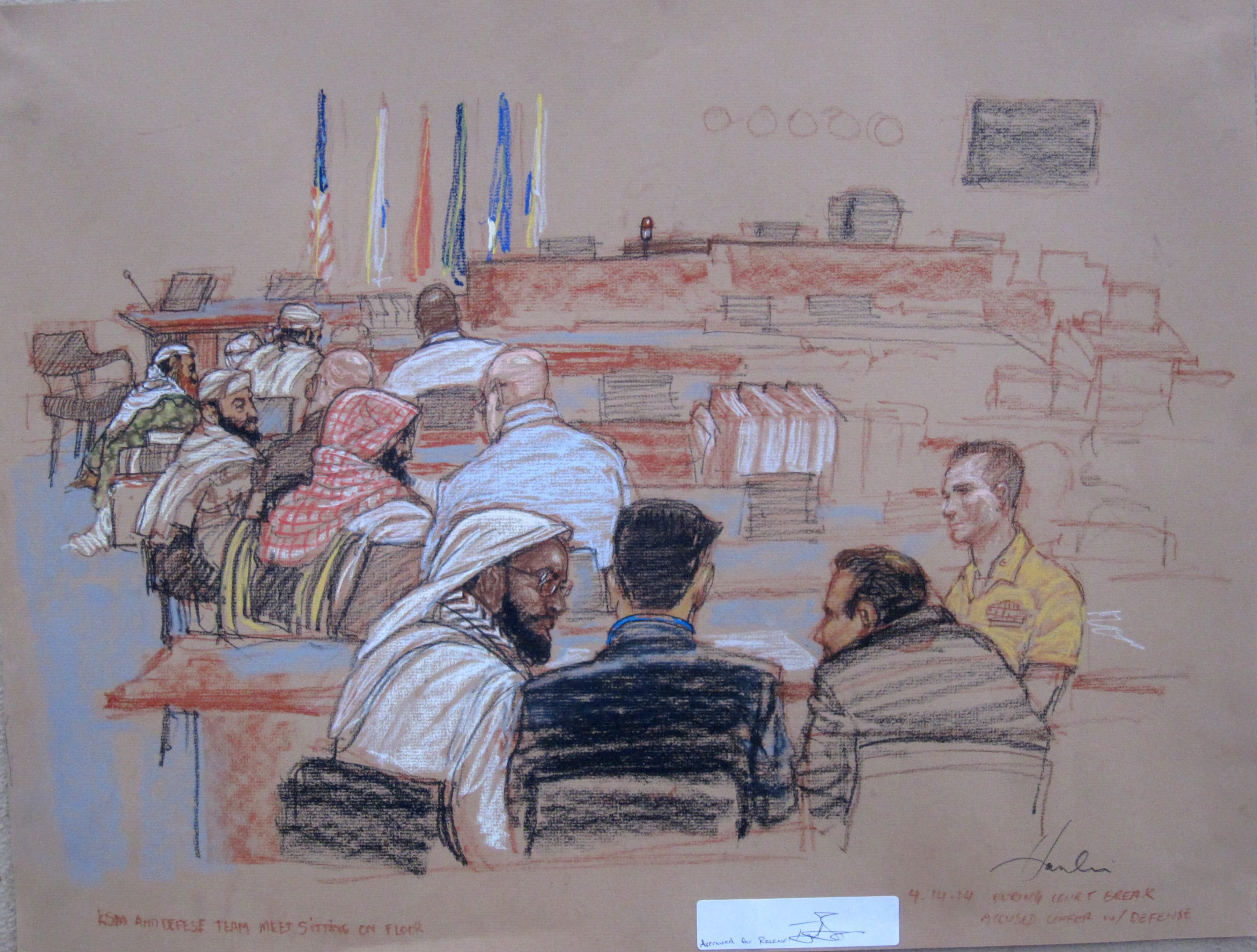 The 9/11 accused confer with their defense lawyers during a break in pretrial hearings at the U.S. Navy base Guantanamo Bay, Cuba, on April 14, 2014.