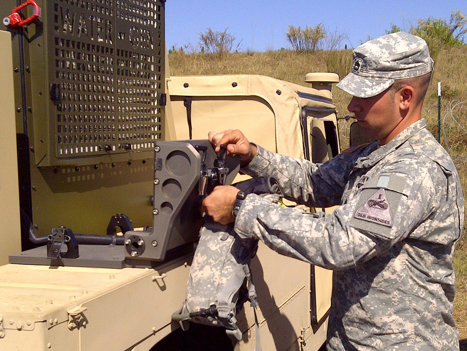 A U.S. Army member pours water generated by Water-Gen's Atmospheric Water-Generation Unit during an exercise.