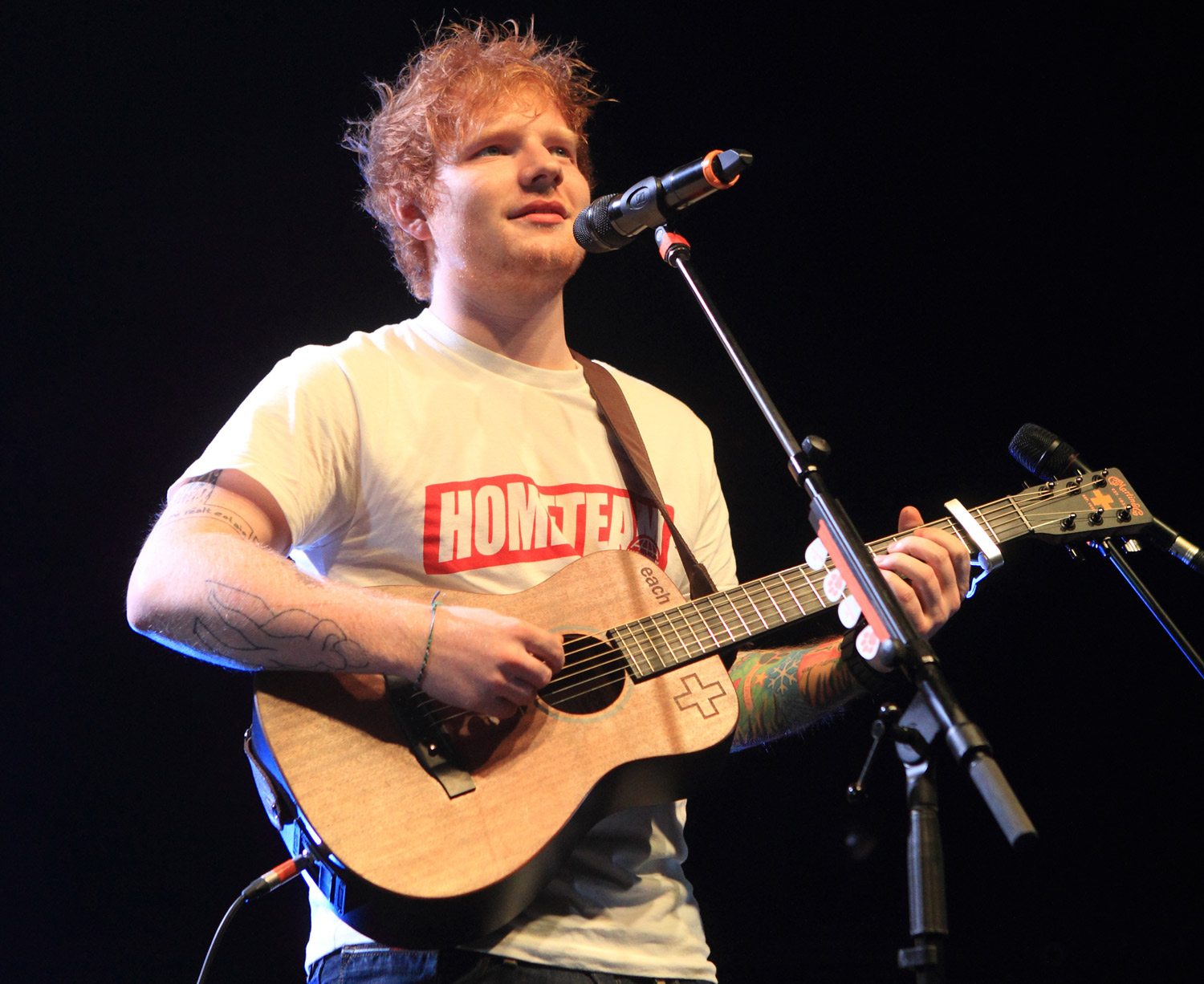 In this Sept. 18, 2013 file photo, English singer songwriter Ed Sheeran performs in concert at the Carpenter Center at the University of Delaware in Newark, Del.